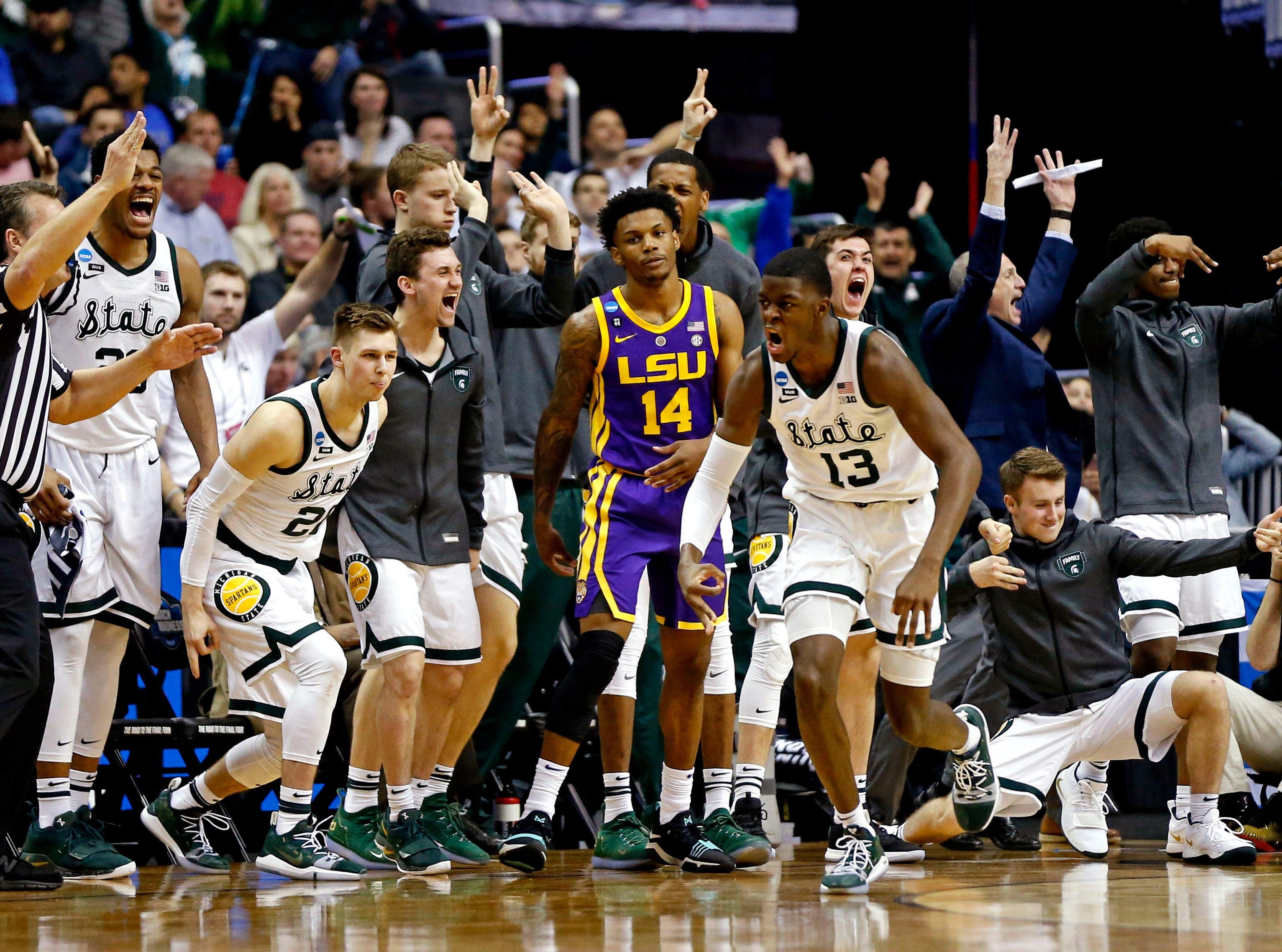 Mar 29, 2019; Washington, DC, USA; Michigan State Spartans forward Gabe Brown (13) celebrates after a basket during the second half against the LSU Tigers in the semifinals of the east regional of the 2019 NCAA Tournament at Capital One Arena. Mandatory Credit: Amber Searls-USA TODAY Sports