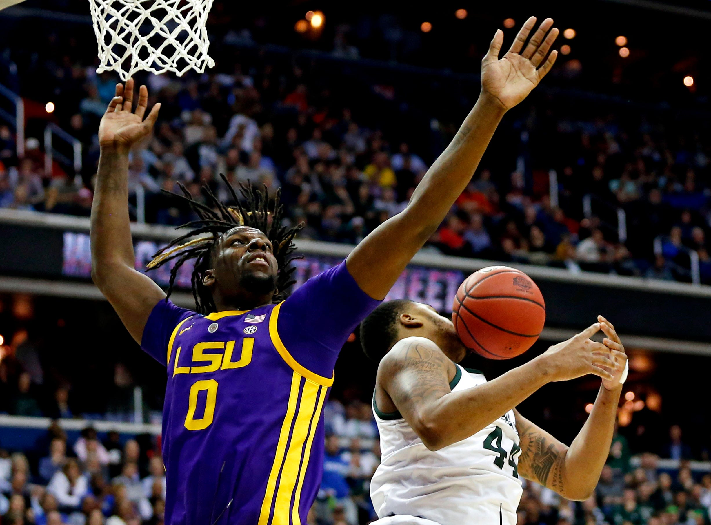 Mar 29, 2019; Washington, DC, USA; LSU Tigers forward Naz Reid (0) and Michigan State Spartans forward Nick Ward (44) go for a rebound during the second half in the semifinals of the east regional of the 2019 NCAA Tournament at Capital One Arena. Mandatory Credit: Amber Searls-USA TODAY Sports