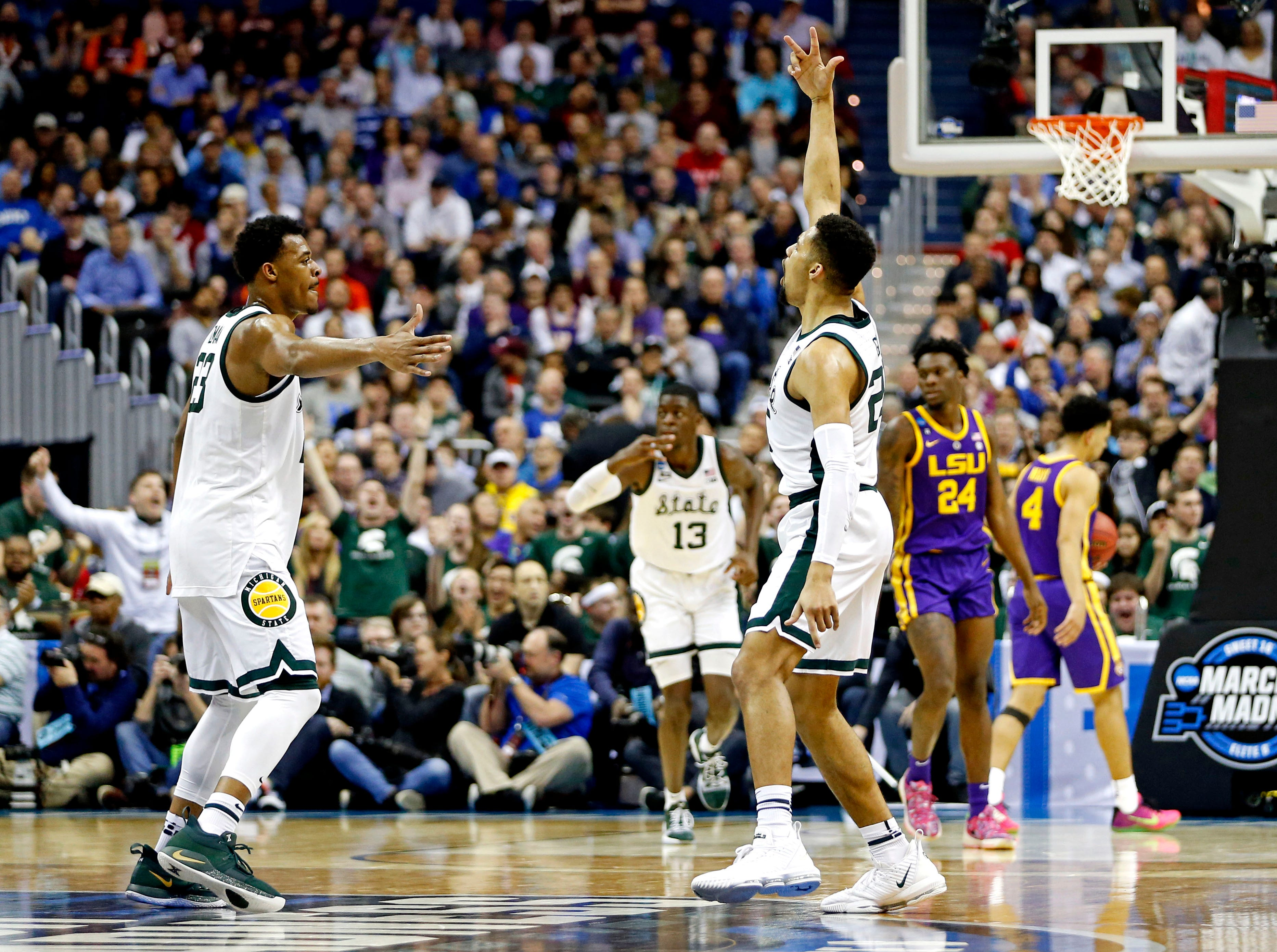 Mar 29, 2019; Washington, DC, USA; Michigan State Spartans forward Xavier Tillman (23) and Michigan State Spartans forward Kenny Goins (25) celebrate during the second half against the LSU Tigers in the semifinals of the east regional of the 2019 NCAA Tournament at Capital One Arena. Mandatory Credit: Amber Searls-USA TODAY Sports