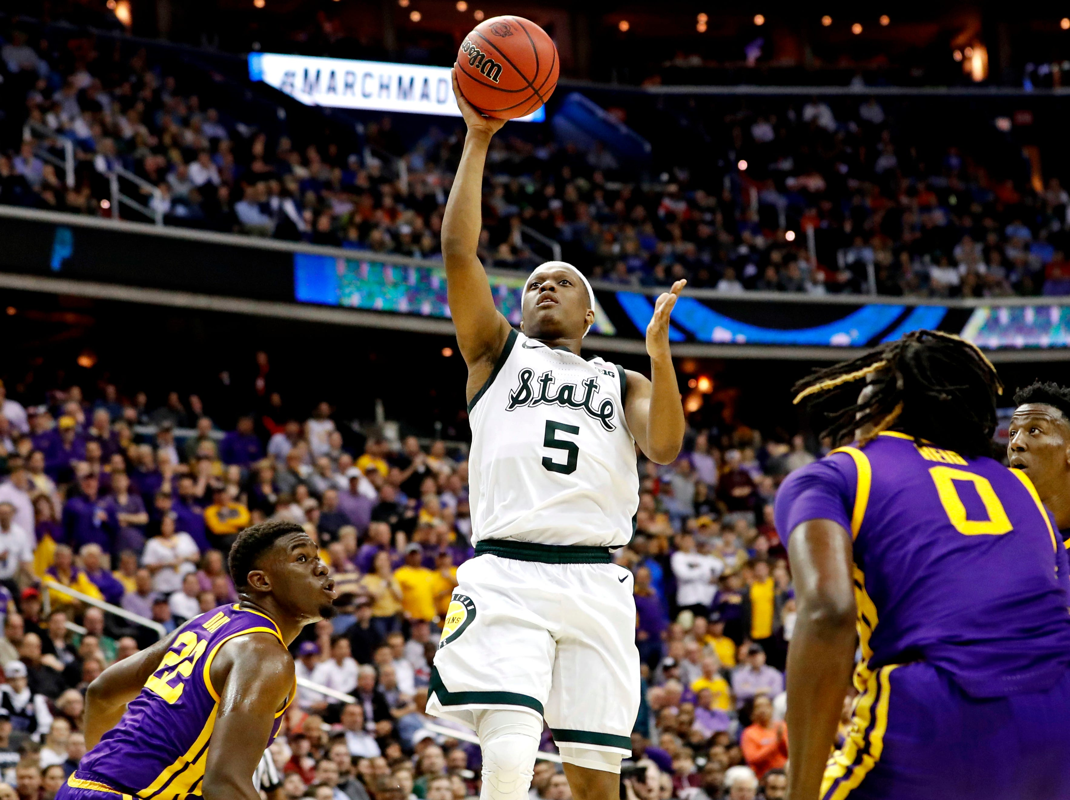 Mar 29, 2019; Washington, DC, USA; Michigan State Spartans guard Cassius Winston (5) shoots the ball against LSU Tigers forward Darius Days (22) during the second half in the semifinals of the east regional of the 2019 NCAA Tournament at Capital One Arena. Mandatory Credit: Geoff Burke-USA TODAY Sports