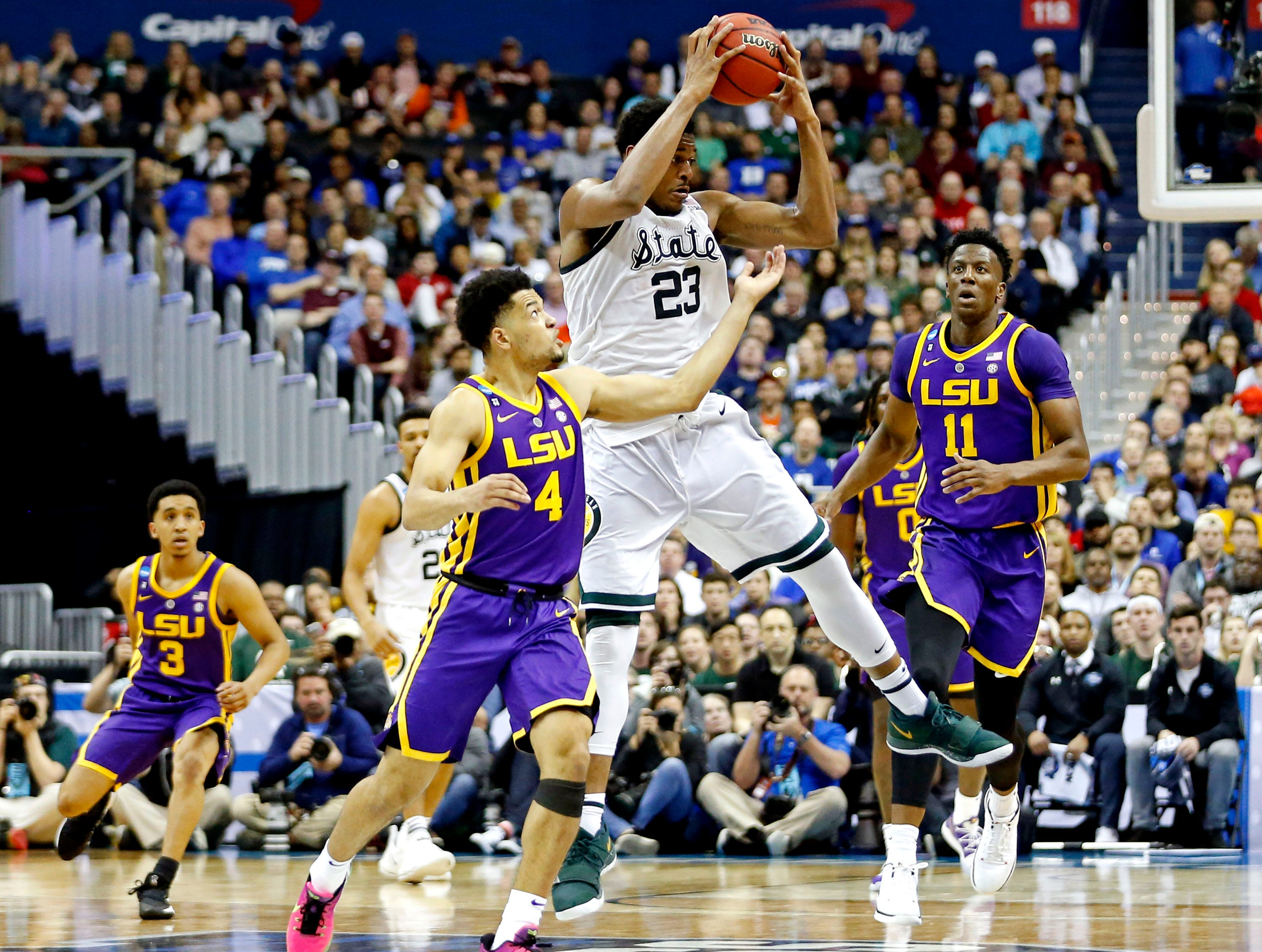 Mar 29, 2019; Washington, DC, USA; Michigan State Spartans forward Xavier Tillman (23) and LSU Tigers guard Skylar Mays (4) go for a loose ball during the second half in the semifinals of the east regional of the 2019 NCAA Tournament at Capital One Arena. Mandatory Credit: Amber Searls-USA TODAY Sports
