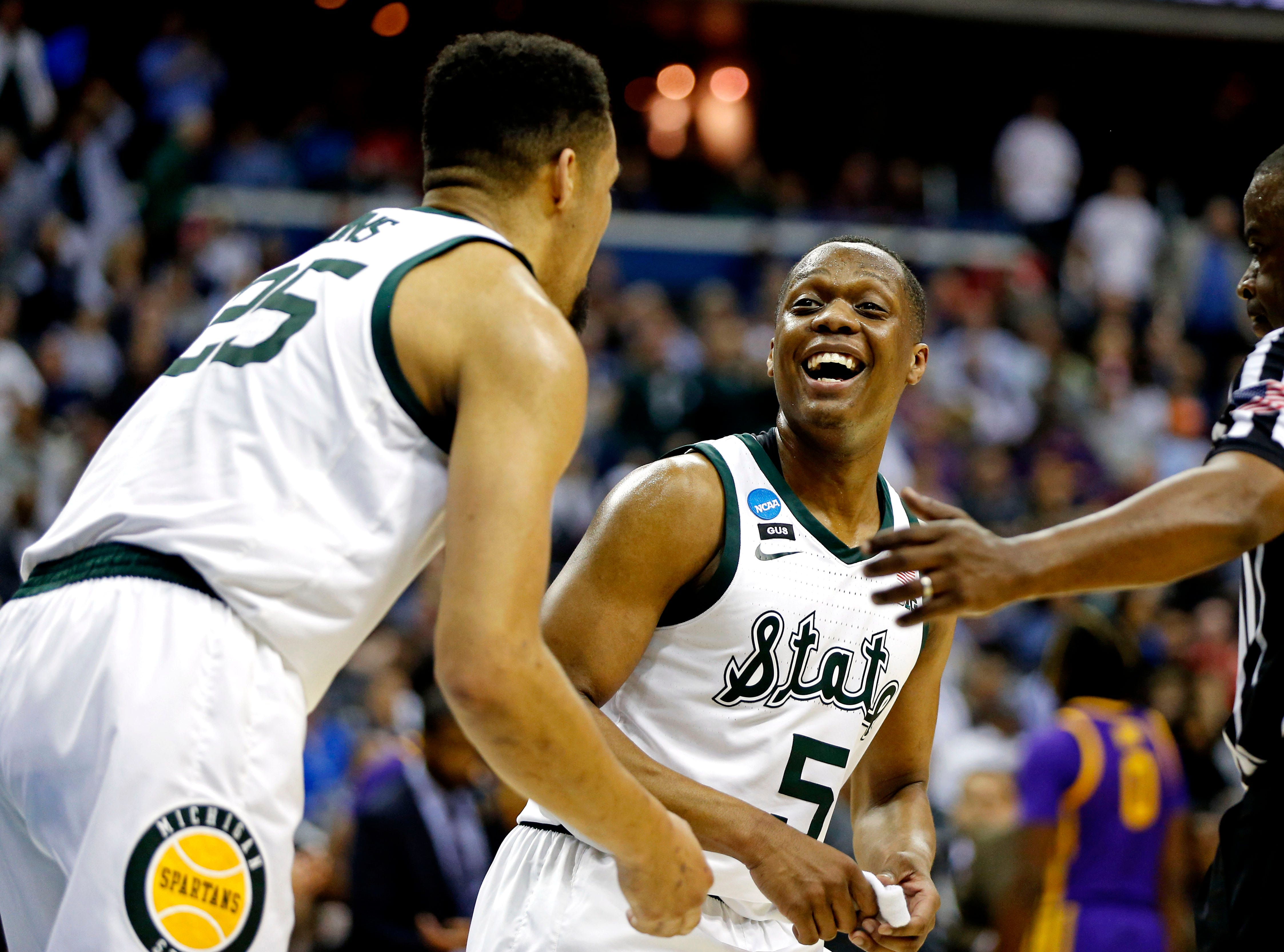 Mar 29, 2019; Washington, DC, USA; Michigan State Spartans guard Cassius Winston (5) and forward Kenny Goins (25) celebrates during the second half against the LSU Tigers in the semifinals of the east regional of the 2019 NCAA Tournament at Capital One Arena. Mandatory Credit: Amber Searls-USA TODAY Sports
