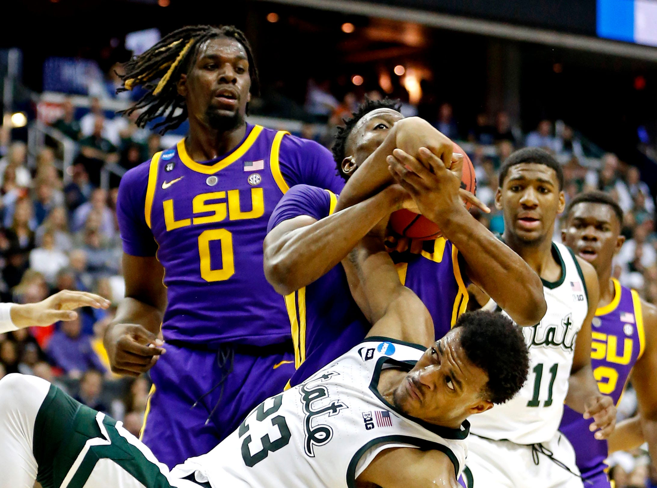 Mar 29, 2019; Washington, DC, USA; Michigan State Spartans forward Xavier Tillman (23) and LSU Tigers forward Kavell Bigby-Williams (11) go for a rebound during the second half in the semifinals of the east regional of the 2019 NCAA Tournament at Capital One Arena. Mandatory Credit: Amber Searls-USA TODAY Sports