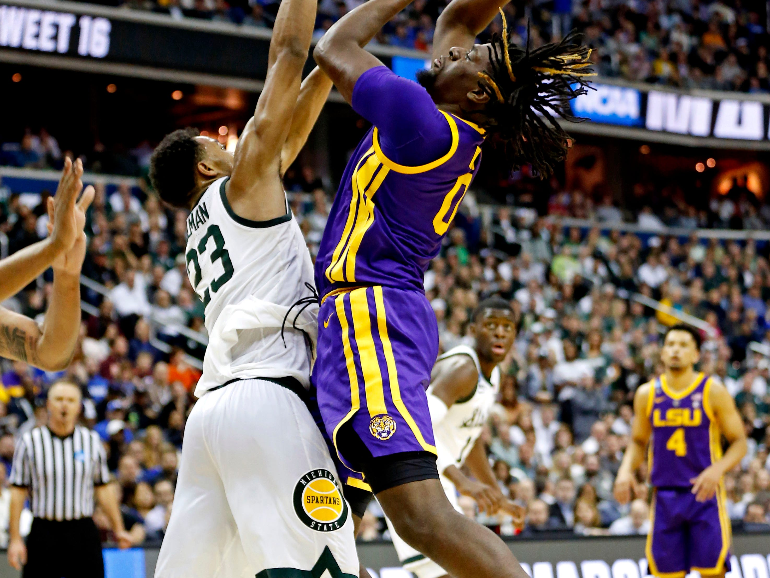 Mar 29, 2019; Washington, DC, USA; LSU Tigers forward Naz Reid (0) shoots the ball against Michigan State Spartans forward Xavier Tillman (23) during the second half in the semifinals of the east regional of the 2019 NCAA Tournament at Capital One Arena. Mandatory Credit: Amber Searls-USA TODAY Sports