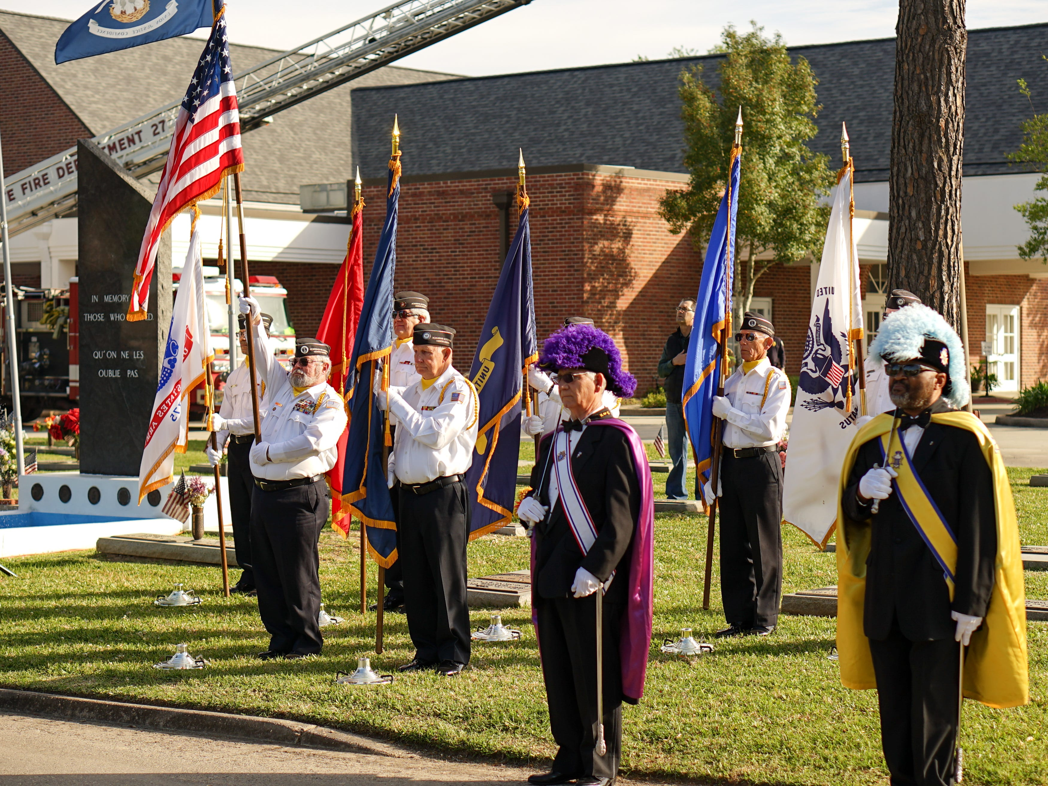 """Members of the Acadiana Veterans Honor Guard and the Knights of Columbus  stand before the memorial during the """"Welcome Home Vietnam Veterans"""" event at Fountain Memorial Funeral Home and Cemetery in Lafayette on Friday, March 29, 2019."""
