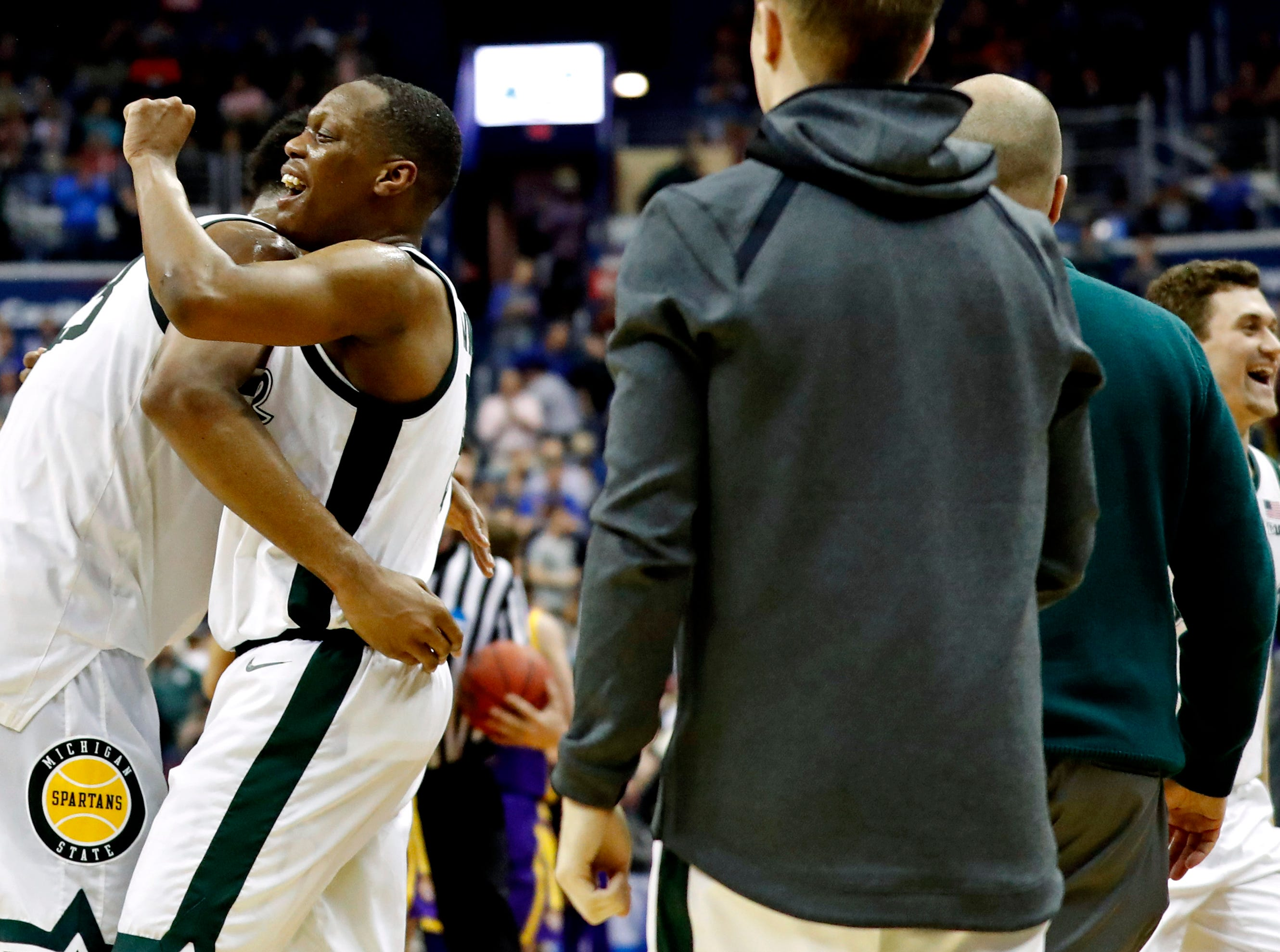 Mar 29, 2019; Washington, DC, USA; Michigan State Spartans guard Cassius Winston (5) celebrates forward Xavier Tillman (23) after beating the LSU Tigers in the semifinals of the east regional of the 2019 NCAA Tournament at Capital One Arena. Mandatory Credit: Geoff Burke-USA TODAY Sports