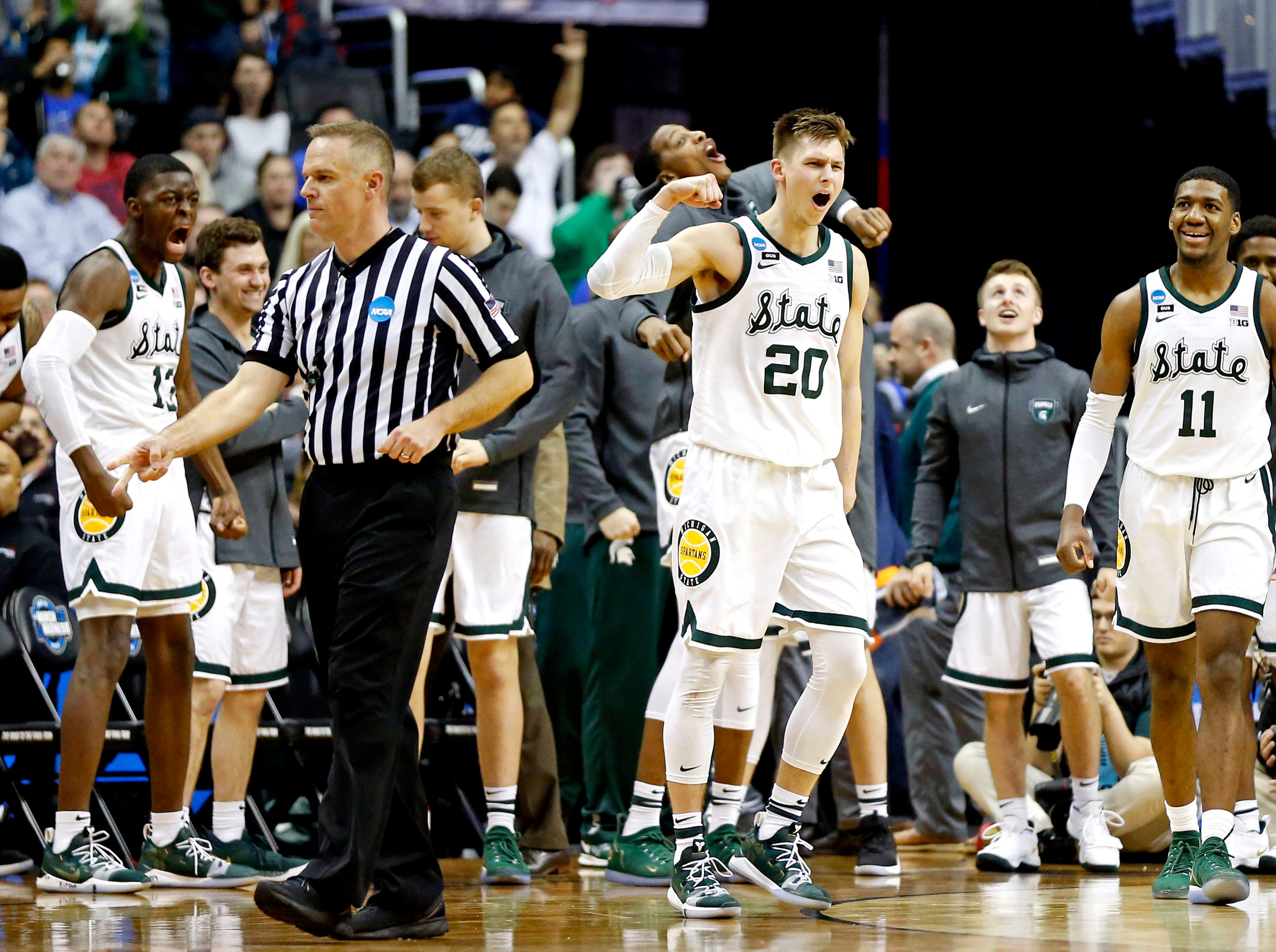 Mar 29, 2019; Washington, DC, USA; Michigan State Spartans guard Matt McQuaid (20) reacts after a play during the second half against the LSU Tigers in the semifinals of the east regional of the 2019 NCAA Tournament at Capital One Arena. Mandatory Credit: Amber Searls-USA TODAY Sports
