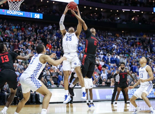 PJ Washington and a Houston player fight for a rebound in Friday's nail-biter.