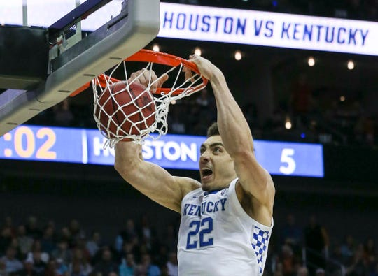 Kentucky's Reid Travis slams down a dunk in the first half against Houston in the Sweet Sixteen. March 29, 2019.