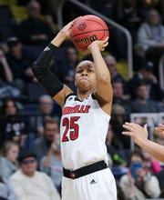 U of L's Asia Durr (25) shoots against the Oregon State defense during the Sweet 16 in Albany, N.Y. Mar. 29, 2019
