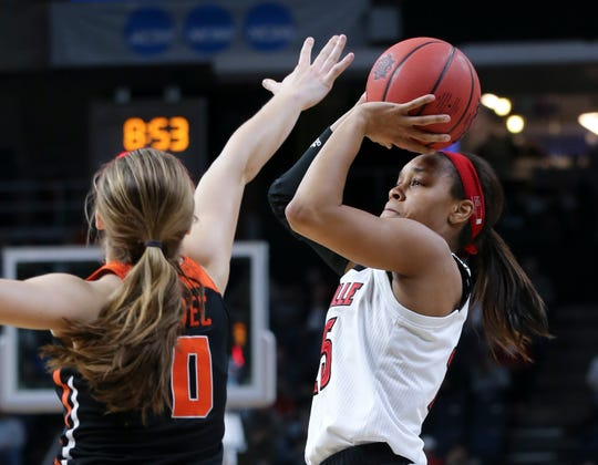 U of L's Asia Durr (25) was fouled as she shot against Oregon State's Mikayla Pivec (0) during the Sweet 16 in Albany, N.Y. Mar. 29, 2019