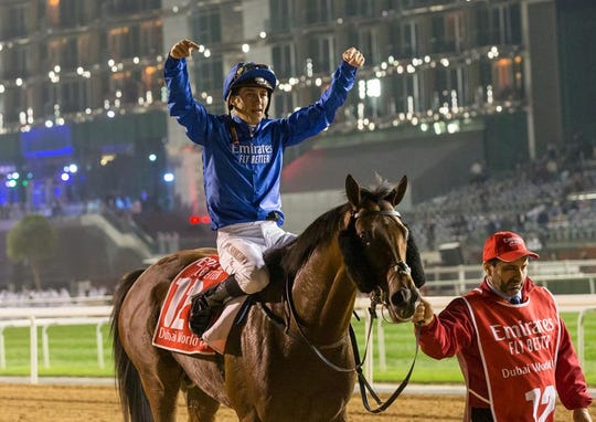 Thunder Snow jockey Christophe Soumillon celebrates after winning Saturday's Dubai World Cup at Meydan Racecourse.