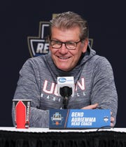 UConn head coach Geno Auriemma smiles as he talks about their upcoming rematch with U of L ahead of their Elite 8 matchup in Albany, N.Y.