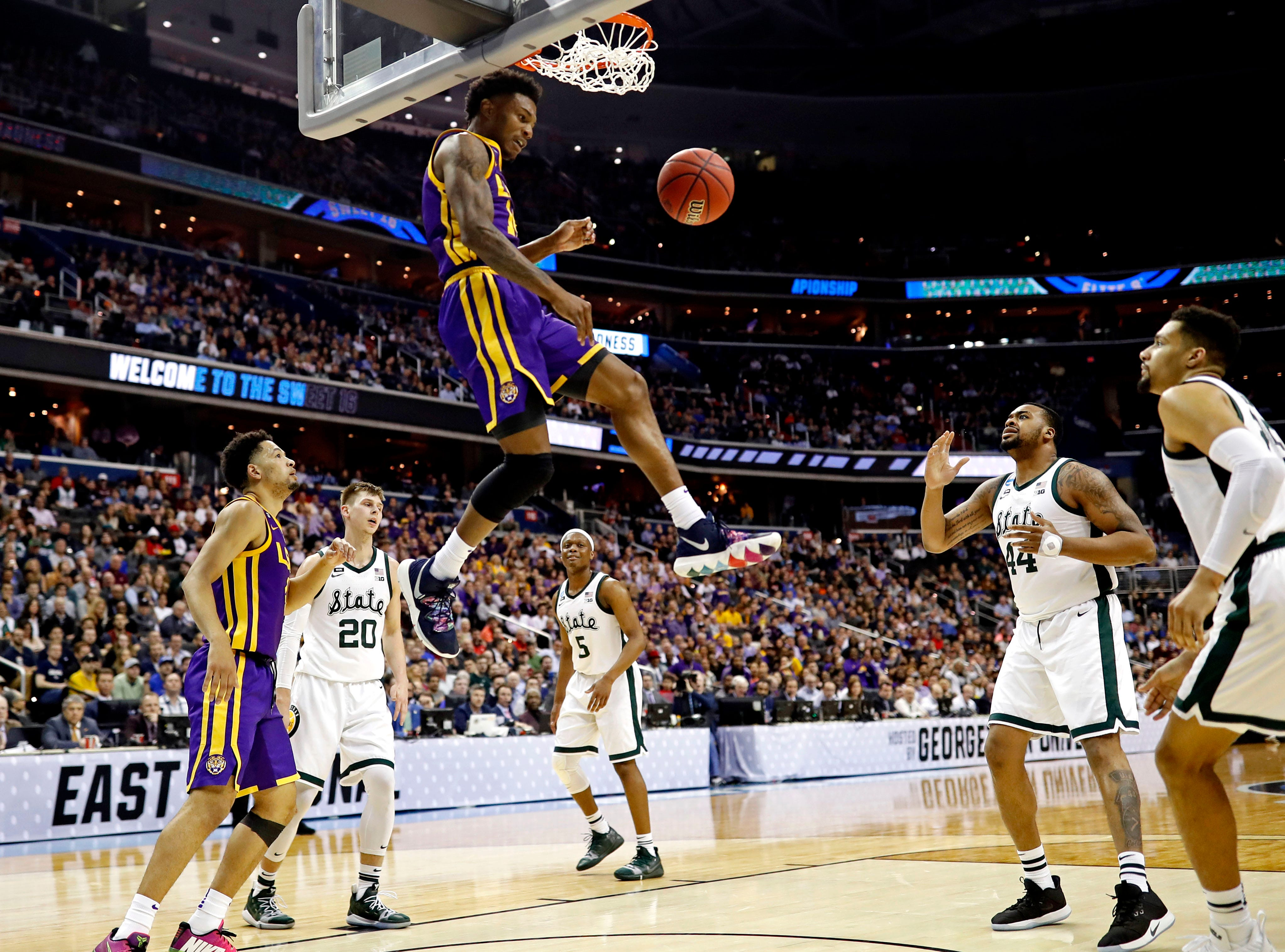 Mar 29, 2019; Washington, DC, USA; LSU Tigers guard Marlon Taylor (14) dunks the ball during the first half against the Michigan State Spartans in the semifinals of the east regional of the 2019 NCAA Tournament at Capital One Arena. Mandatory Credit: Geoff Burke-USA TODAY Sports