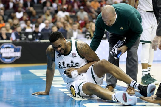 Nick Ward #44 of the Michigan State Spartans reacts after being injured against the LSU Tigers during the second half in the East Regional game of the 2019 NCAA Men's Basketball Tournament at Capital One Arena on March 29, 2019 in Washington, DC.