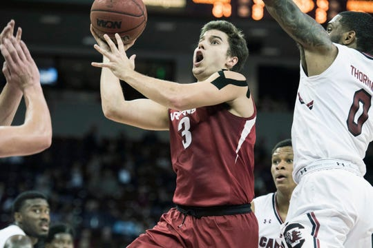 Arkansas guard Dusty Hannahs (3) drives to the hoop against South Carolina guard Sindarius Thornwell (0) during the first half of an NCAA college basketball game, Wednesday, Feb. 15, 2017, in Columbia, S.C. (AP Photo/Sean Rayford)