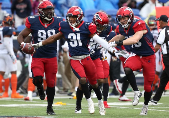 Memphis Express defensive back Jonathan Cook, center, celebrates an interception with his teammates against the Orlando Apollos during their game at the Liberty Bowl Memorial Stadium on Saturday, March 30, 2019.