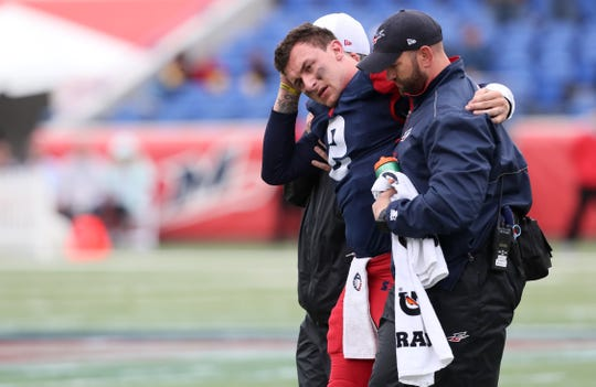 Memphis Express quarterback Johnny Manziel is helped off the field after being injured against the Orlando Apollos during their game at the Liberty Bowl Memorial Stadium on Saturday, March 30, 2019.