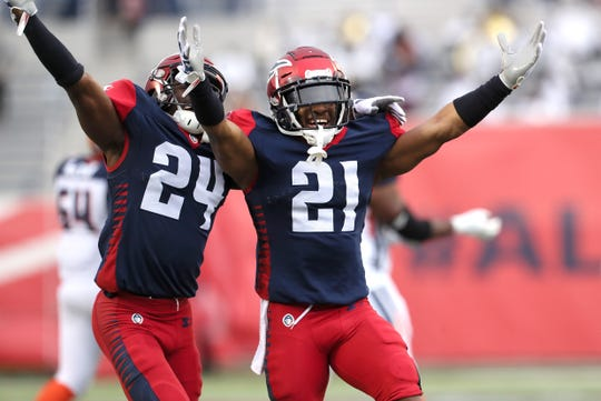 Memphis Express defensive backs Charles James II, left, and Terrell Bonds celebrate an interception against the Orlando Apollos during their game at the Liberty Bowl Memorial Stadium on Saturday, March 30, 2019. The play was later nulified by an off-the-ball penalty.