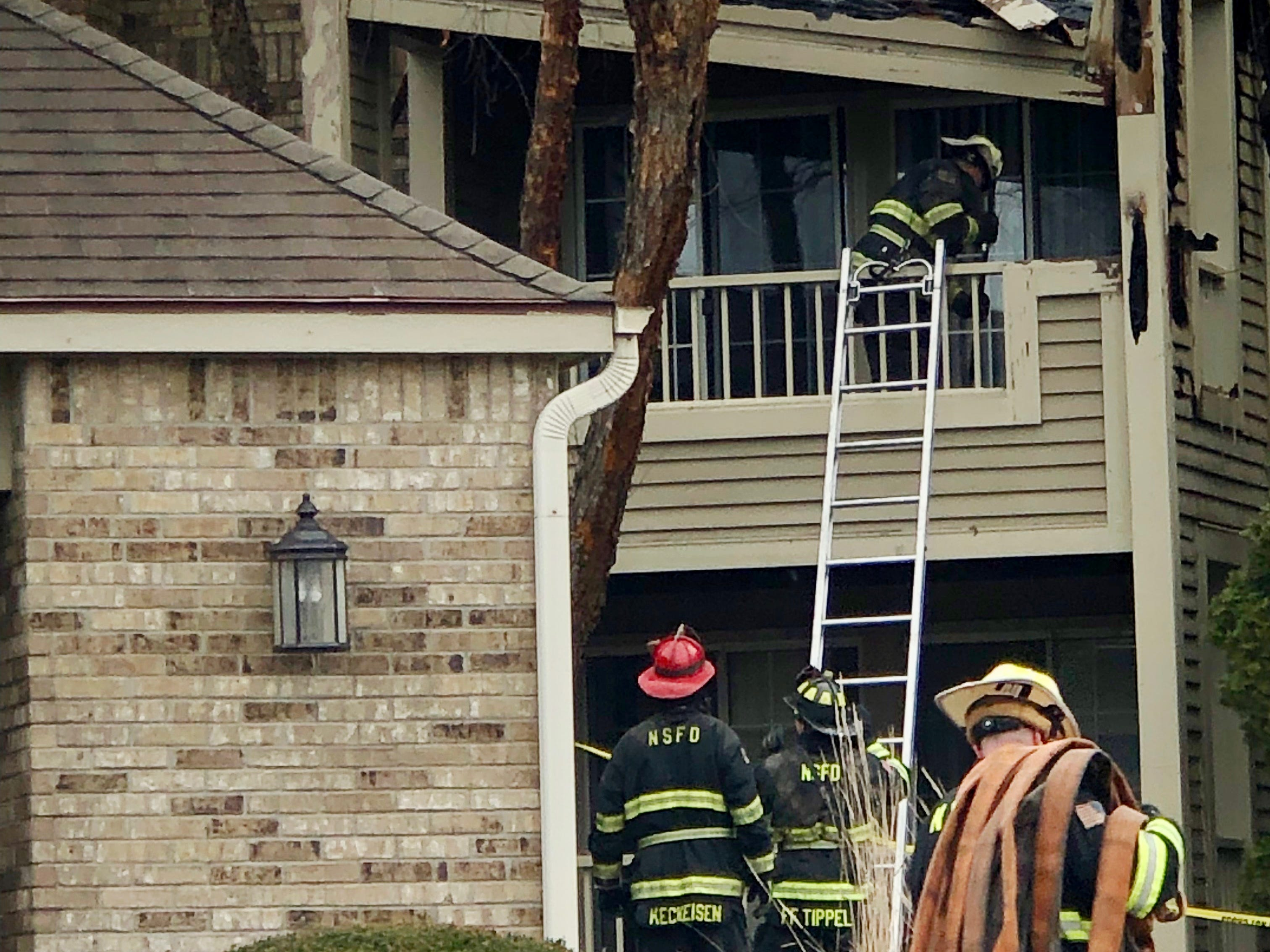 Firefighters on the scene search an apartment at White Oaks in Bayside.