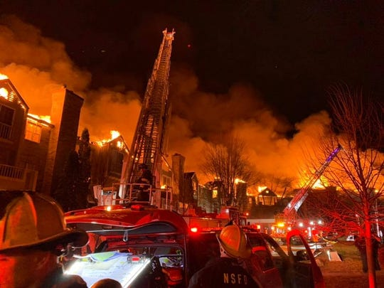 A massive fire burns at the White Oaks apartment complex in Bayside.