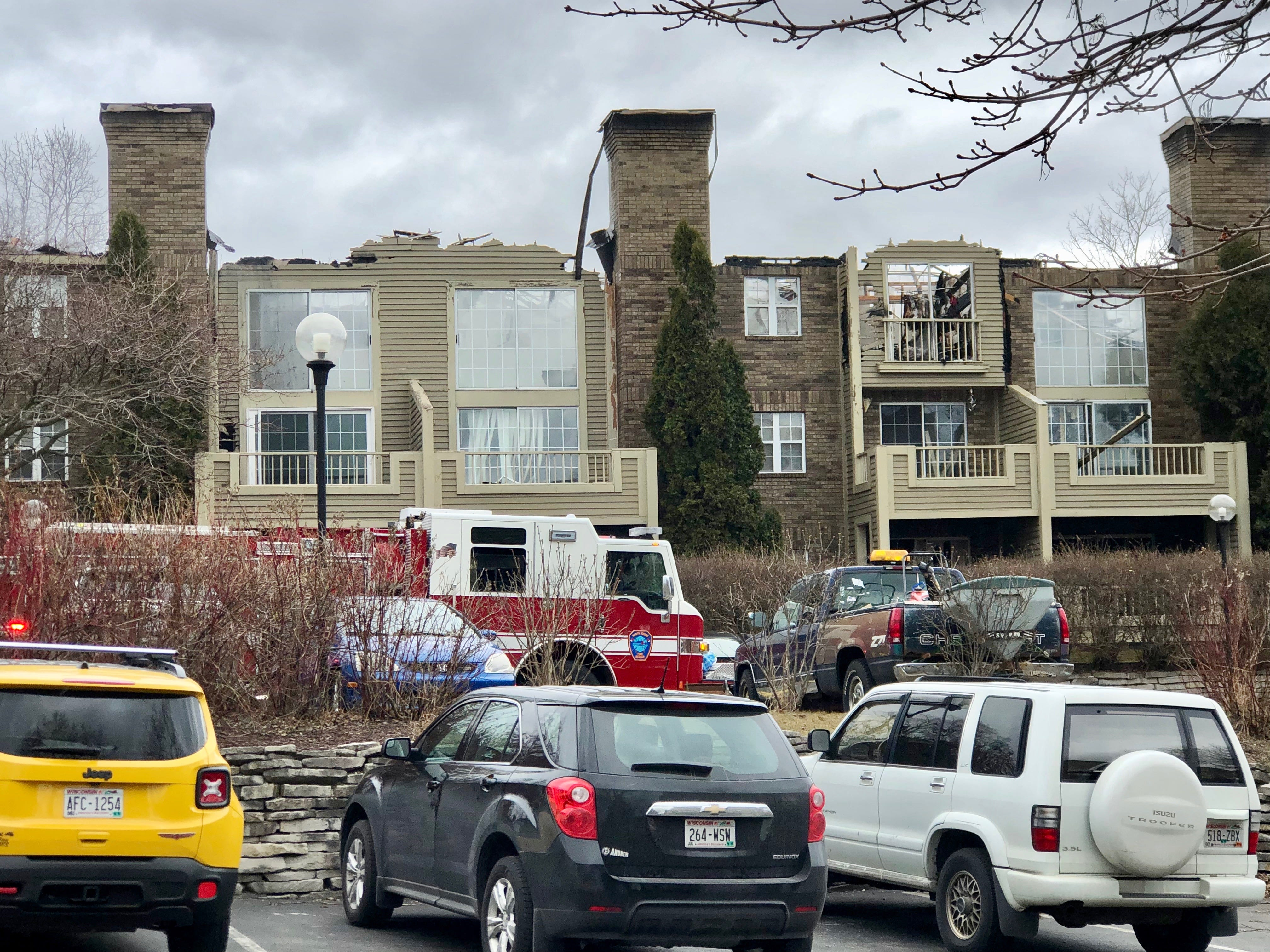 The roof of the White Oaks apartment building is open to the sky following the early morning fire.