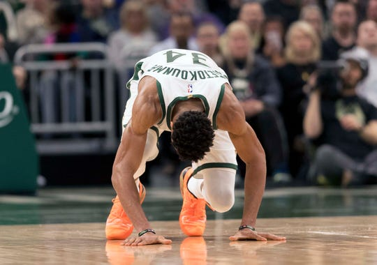 Mar 28, 2019; Milwaukee, WI, USA; Milwaukee Bucks forward Giannis Antetokounmpo (34) falls to the court after injuring his ankle during the fourth quarter against the LA Clippers at Fiserv Forum. Mandatory Credit: Jeff Hanisch-USA TODAY Sports