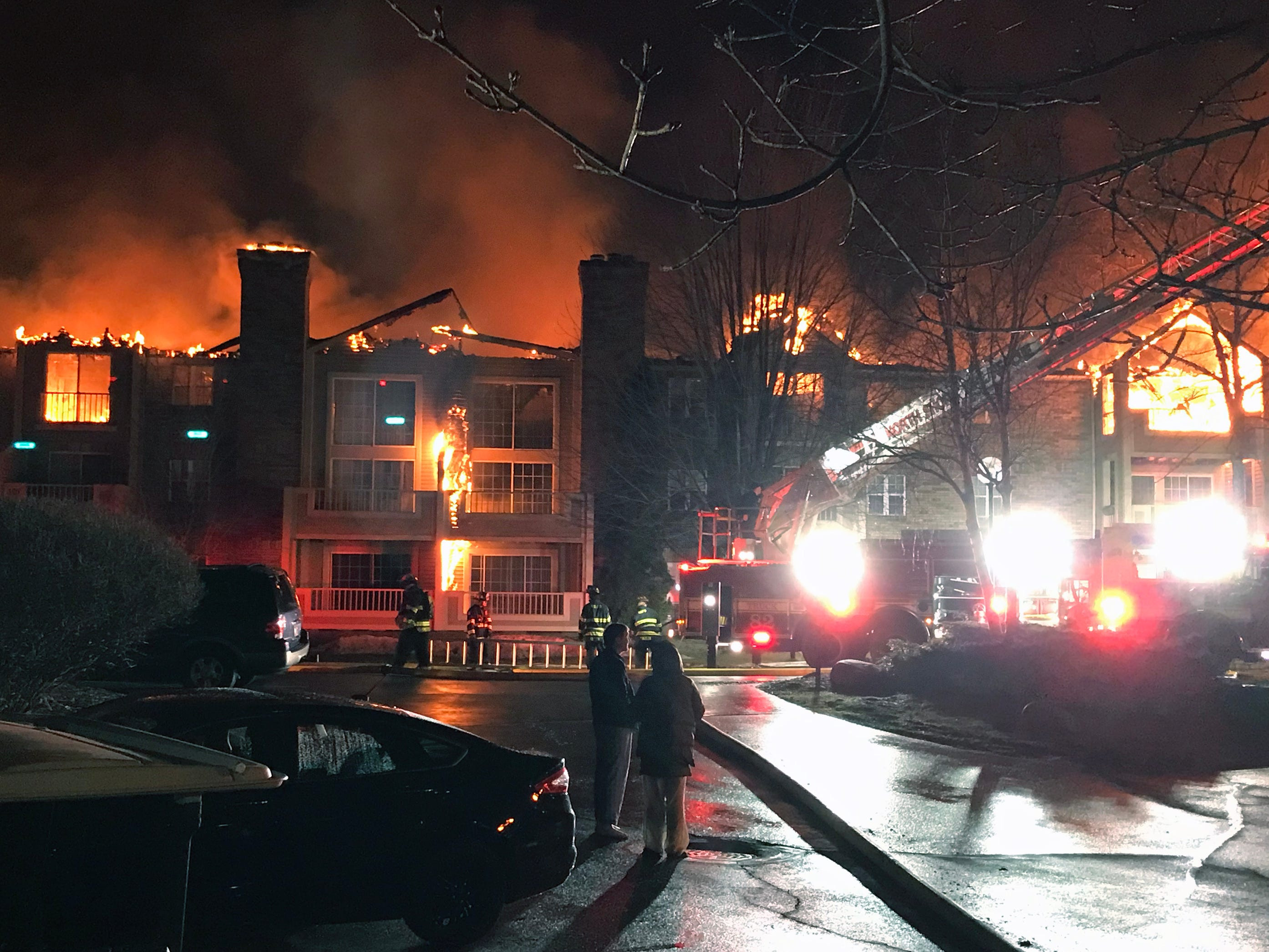 A building in the White Oaks apartment complex burns during an early morning fire.