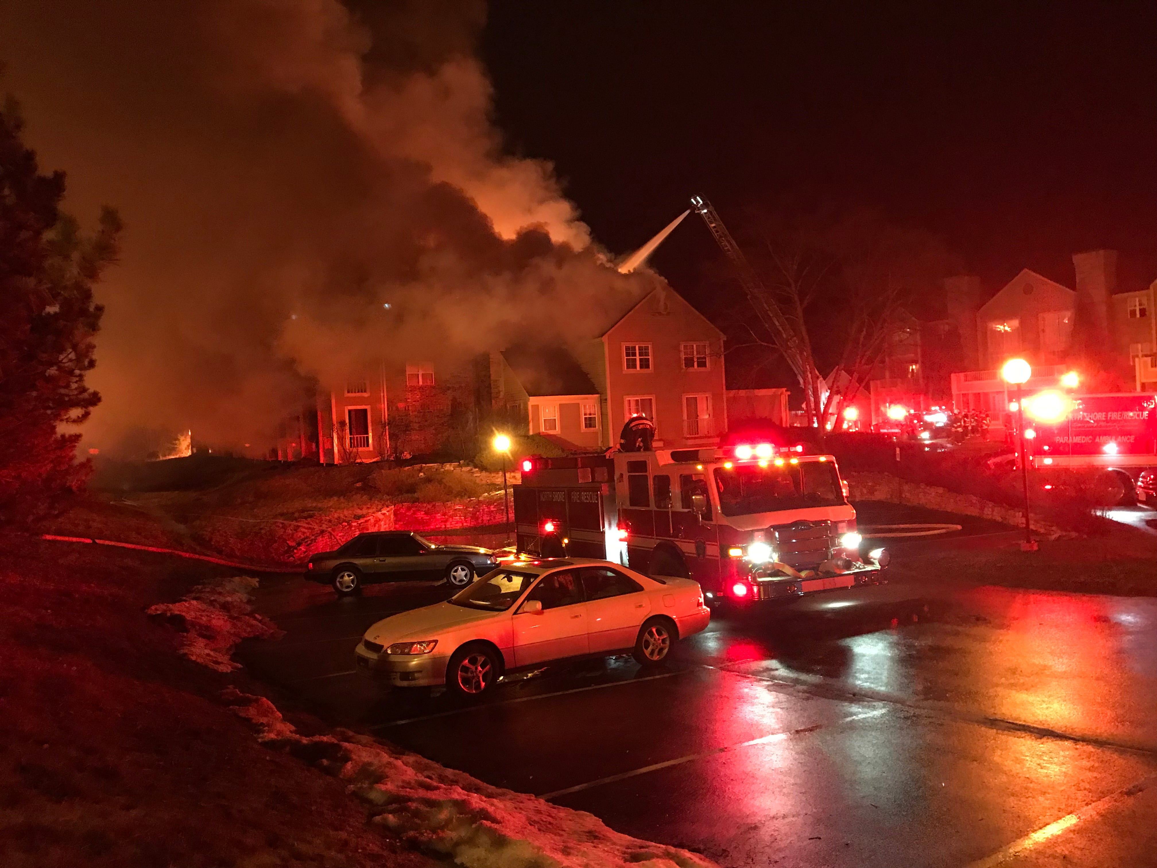 Firefighters douse flames at the White Oaks apartment complex in Bayside.
