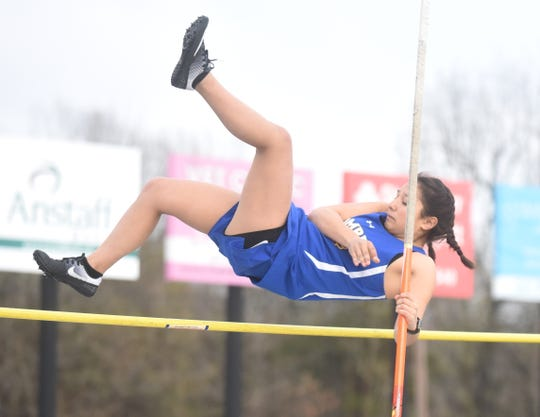 Mountain Home's Joia Traver clears the bar in the pole vault.