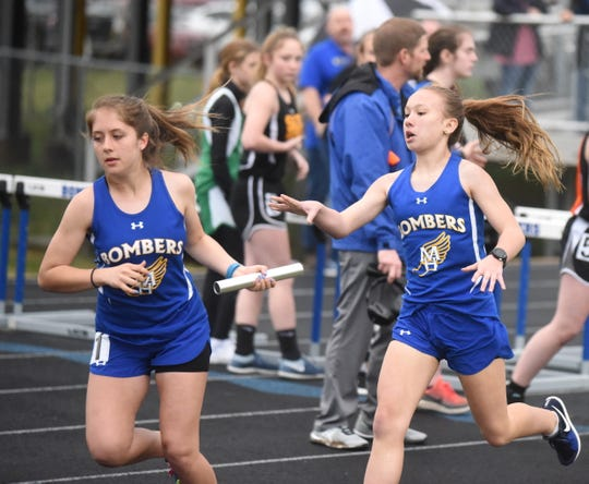Mountain Home's Cayla McMaster hands off to Rylee Patterson in the 4x800.