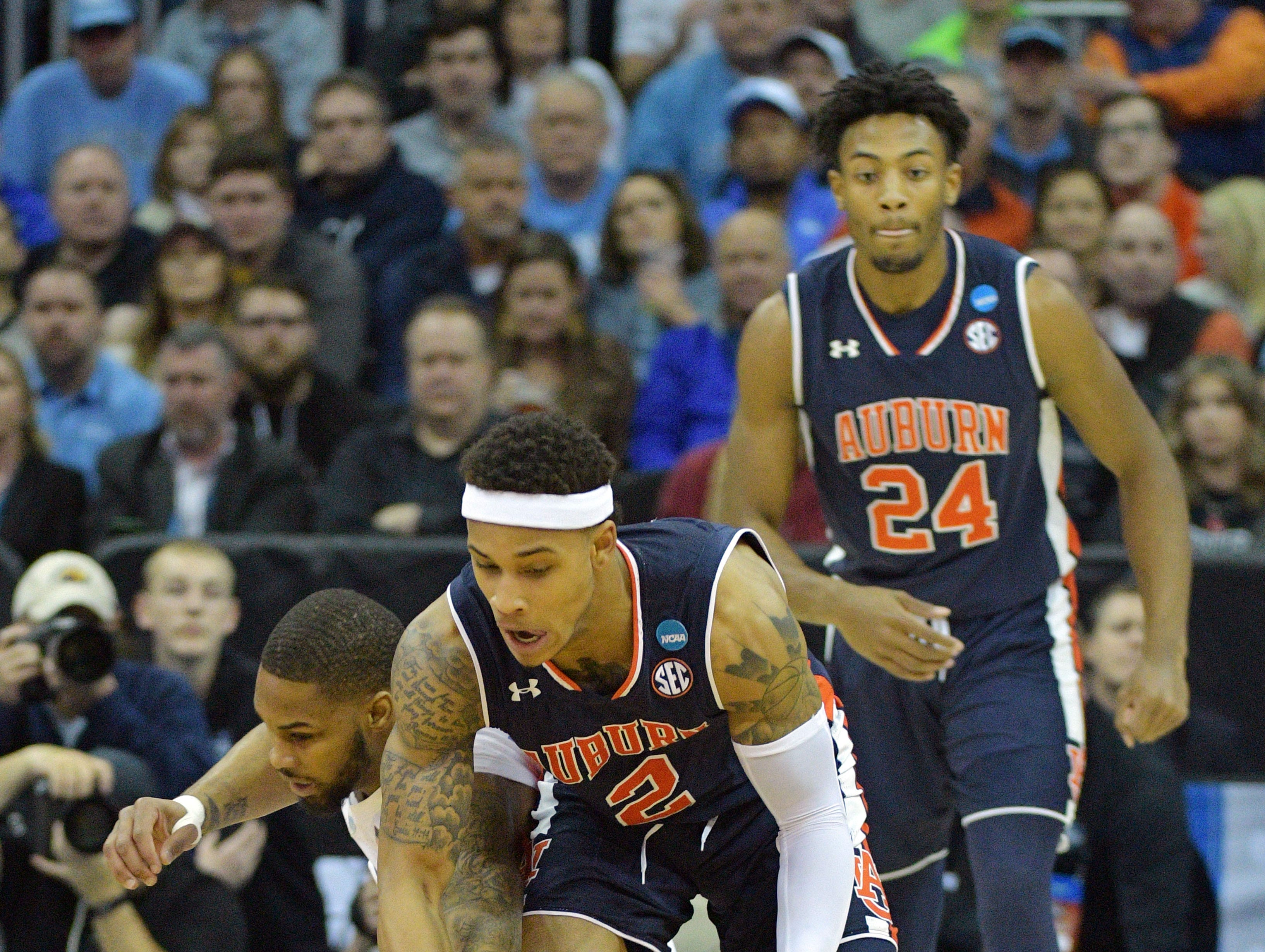 Mar 29, 2019; Kansas City, MO, United States; Auburn Tigers guard Bryce Brown (2) battles for a loose ball with North Carolina Tar Heels guard Seventh Woods (0) during the first half in the semifinals of the midwest regional of the 2019 NCAA Tournament at Sprint Center. Mandatory Credit: Denny Medley-USA TODAY Sports