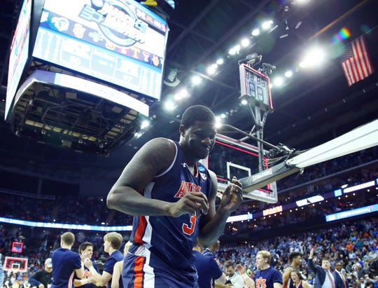 Auburn forward Danjel Purifoy (3) celebrates after defeating North Carolina in the Sweet 16 of the NCAA Tournament at Sprint Center on Marchh 29, 2019, in Kansas City, Mo.