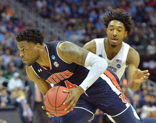 Mar 29, 2019; Kansas City, MO, United States; Auburn Tigers guard Malik Dunbar (4) gets past North Carolina Tar Heels guard Leaky Black (1) during the first half in the semifinals of the midwest regional of the 2019 NCAA Tournament at Sprint Center. Mandatory Credit: Denny Medley-USA TODAY Sports