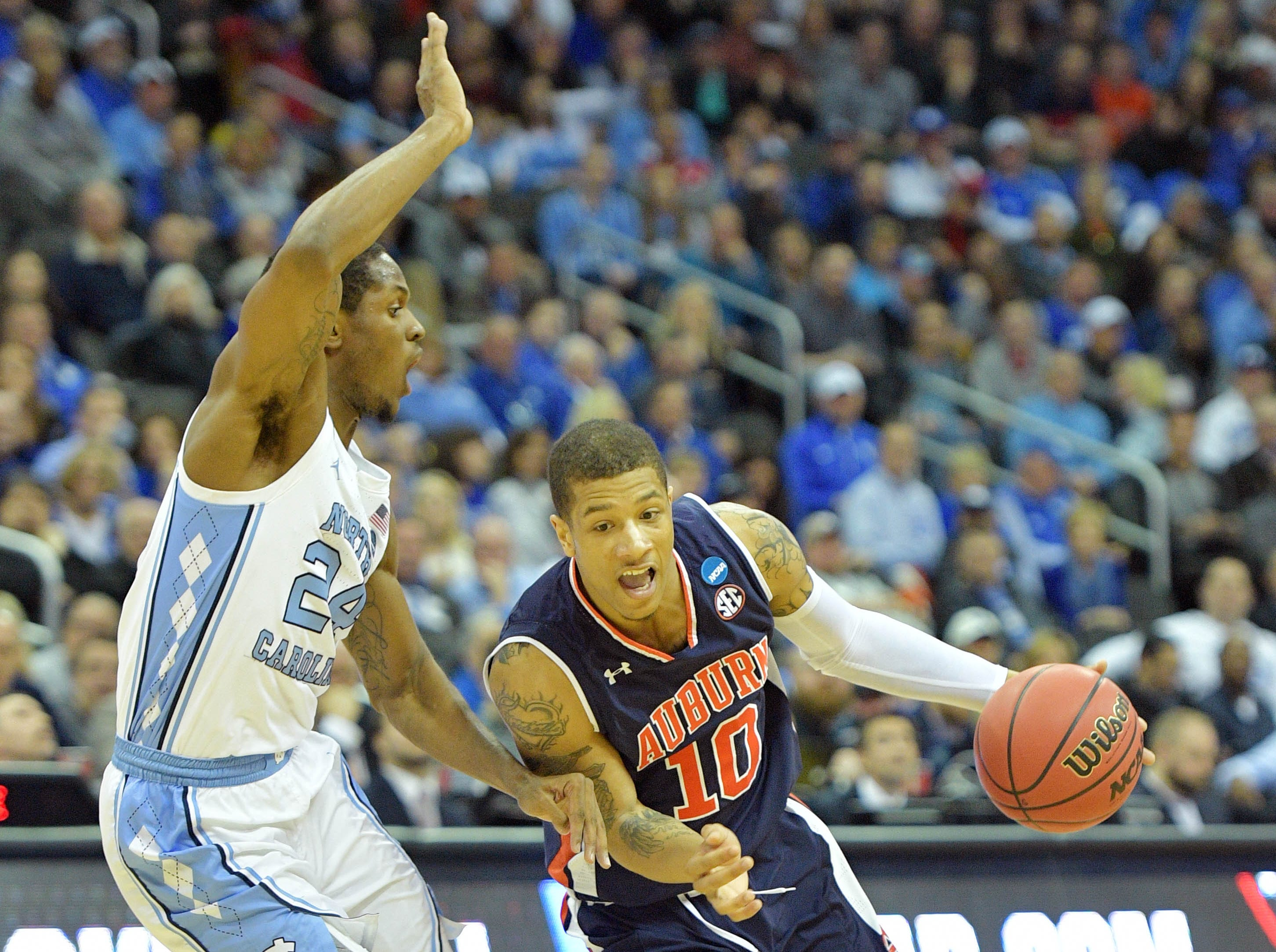 Mar 29, 2019; Kansas City, MO, United States; Auburn Tigers guard Samir Doughty (10) drives to the basket against North Carolina Tar Heels guard Kenny Williams (24) during the first half in the semifinals of the midwest regional of the 2019 NCAA Tournament at Sprint Center. Mandatory Credit: Denny Medley-USA TODAY Sports