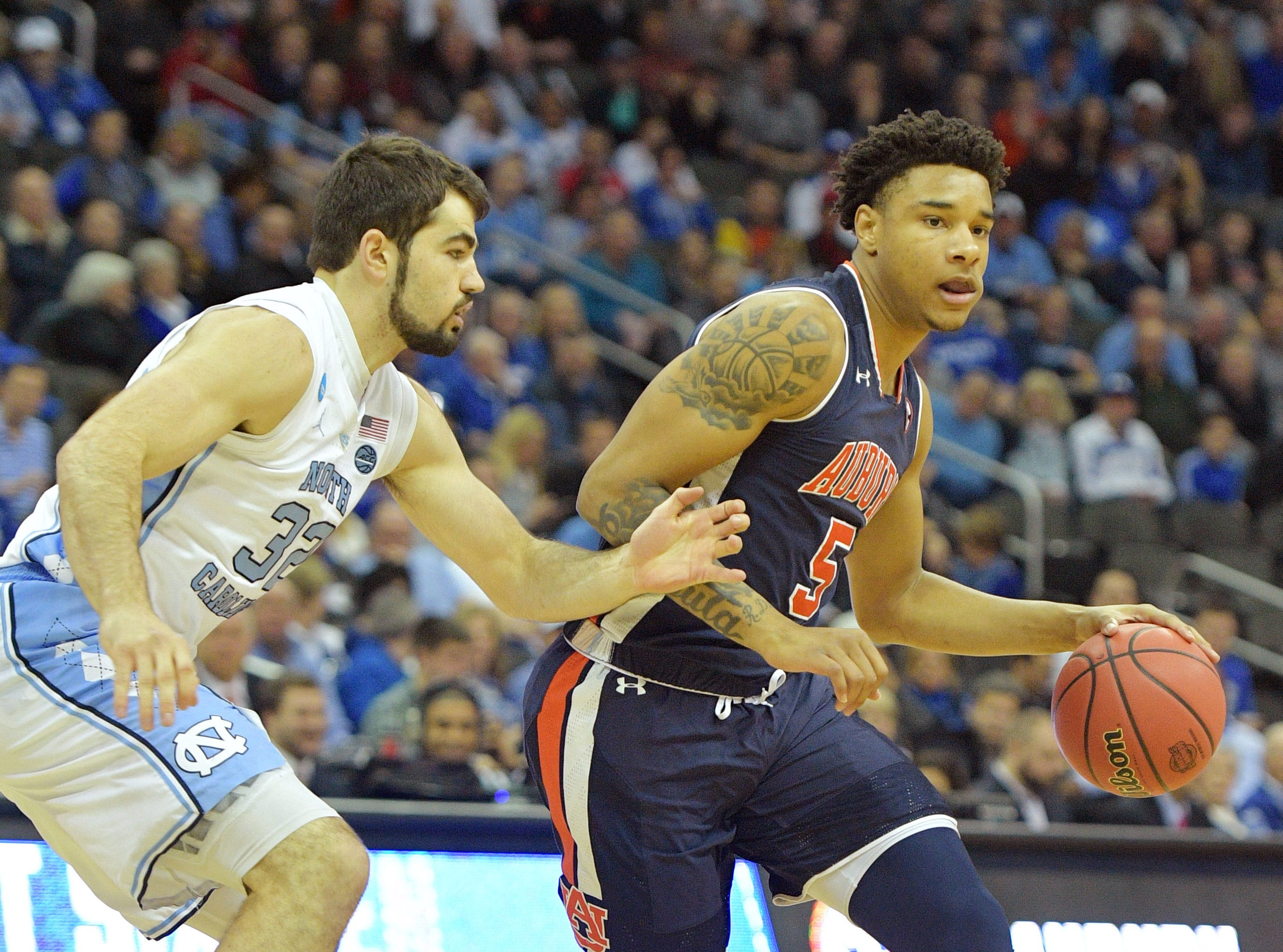 Mar 29, 2019; Kansas City, MO, United States; Auburn Tigers forward Chuma Okeke (5) controls the ball against North Carolina Tar Heels forward Luke Maye (32) during the first half in the semifinals of the midwest regional of the 2019 NCAA Tournament at Sprint Center. Mandatory Credit: Denny Medley-USA TODAY Sports