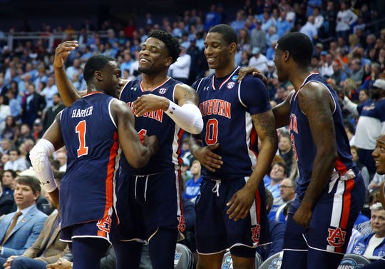 Auburn Tigers guard Jared Harper (1) celebrates with teammates against the North Carolina Tar Heels during the second half in the semifinals of the midwest regional of the 2019 NCAA Tournament at Sprint Center on March 29, 2019, in Kansas City