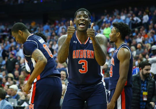 Mar 29, 2019; Kansas City, MO, United States; Auburn Tigers forward Danjel Purifoy (3) celebrates with teammates against the North Carolina Tar Heels during the second half in the semifinals of the midwest regional of the 2019 NCAA Tournament at Sprint Center. Mandatory Credit: Jay Biggerstaff-USA TODAY Sports