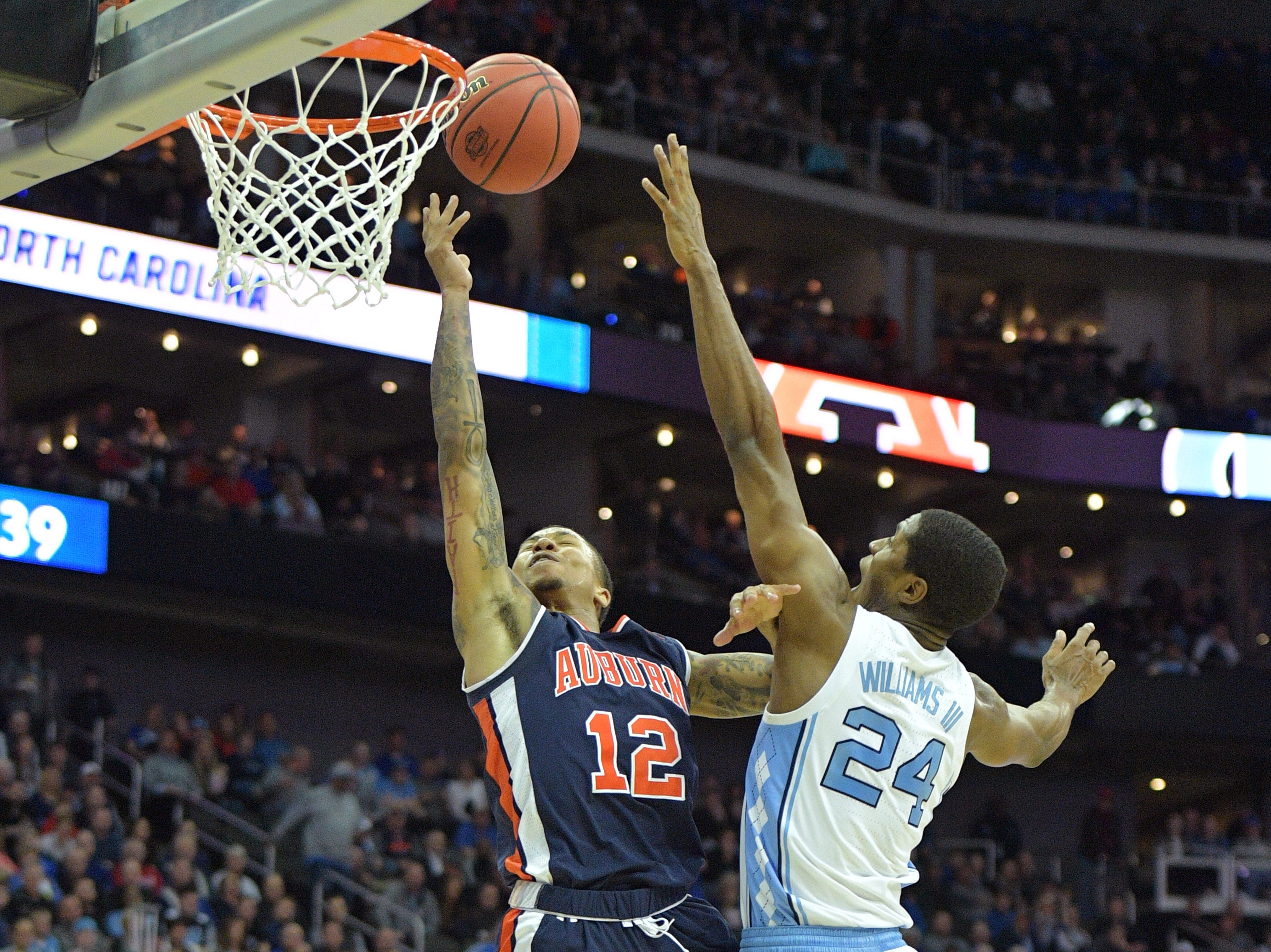 Mar 29, 2019; Kansas City, MO, United States; Auburn Tigers guard J'Von McCormick (12) shoots against North Carolina Tar Heels guard Kenny Williams (24) during the first half in the semifinals of the midwest regional of the 2019 NCAA Tournament at Sprint Center. Mandatory Credit: Denny Medley-USA TODAY Sports