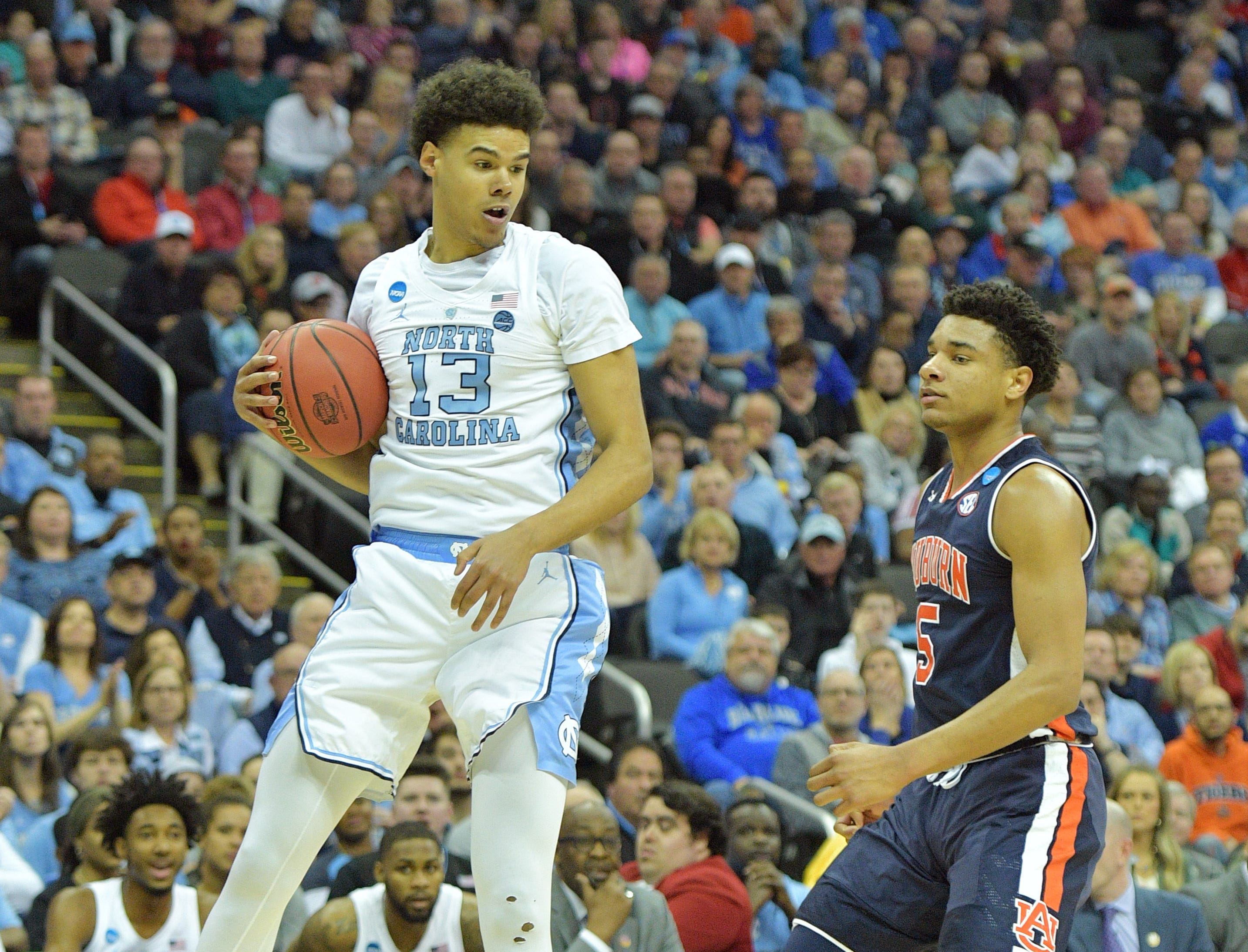 Mar 29, 2019; Kansas City, MO, United States; North Carolina Tar Heels guard Cameron Johnson (13) rebounds the ball against Auburn Tigers forward Chuma Okeke (5) during the first half in the semifinals of the midwest regional of the 2019 NCAA Tournament at Sprint Center. Mandatory Credit: Denny Medley-USA TODAY Sports