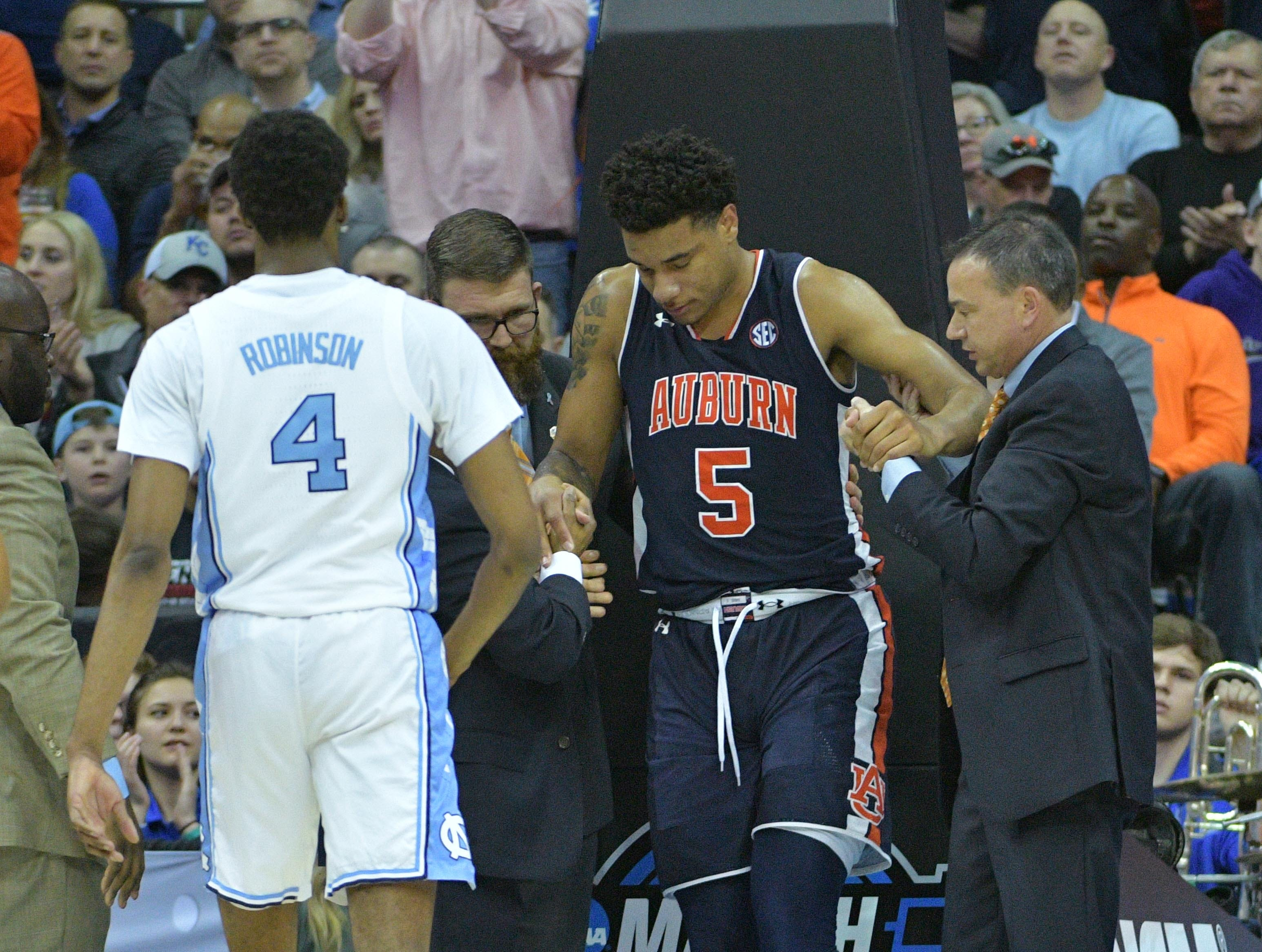 Mar 29, 2019; Kansas City, MO, United States; Auburn Tigers forward Chuma Okeke (5) is helped up after suffering an apparent injury against the North Carolina Tar Heels during the second half in the semifinals of the midwest regional of the 2019 NCAA Tournament at Sprint Center. Mandatory Credit: Denny Medley-USA TODAY Sports