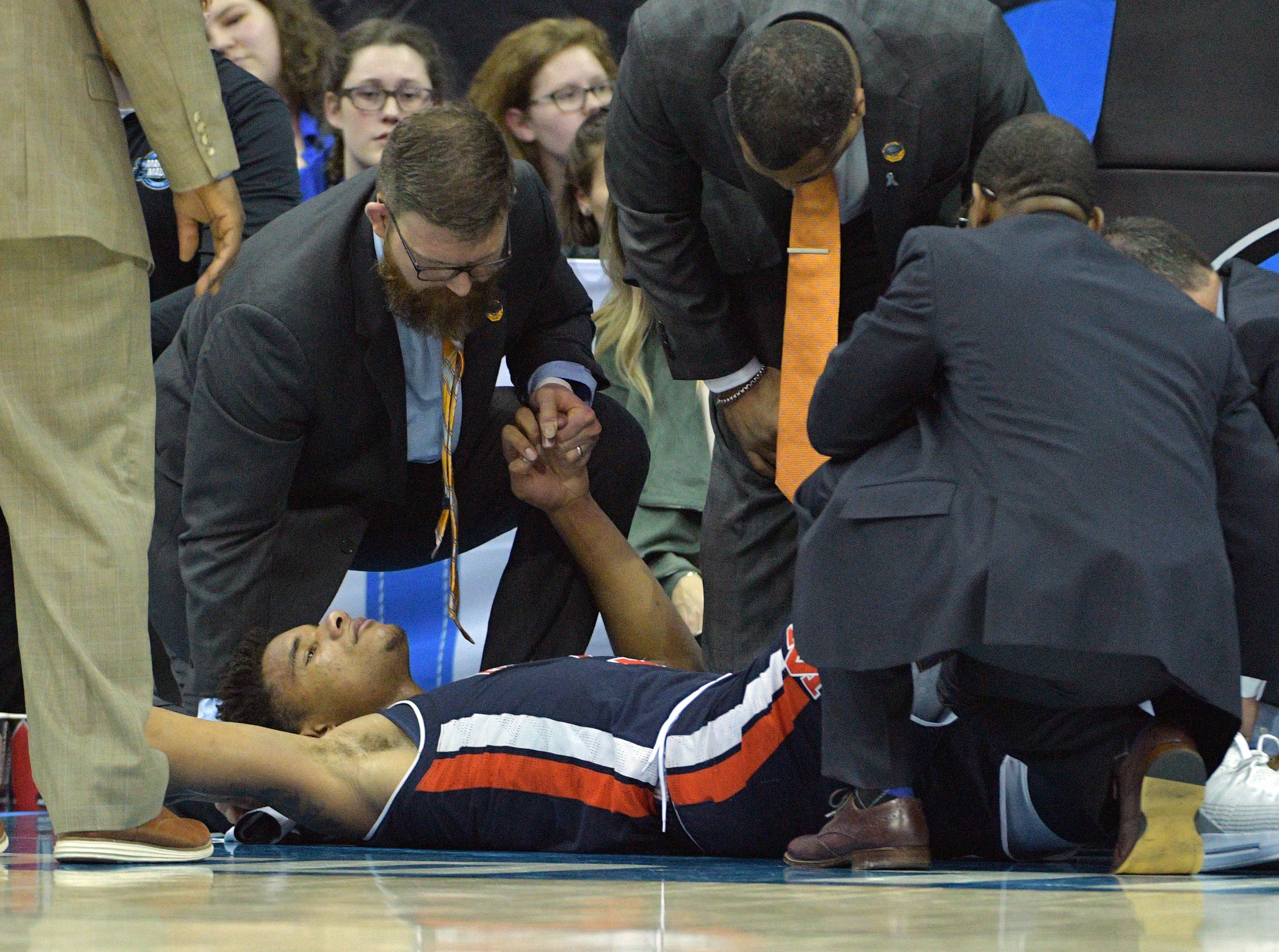 Mar 29, 2019; Kansas City, MO, United States; Auburn Tigers forward Chuma Okeke (5) is treated after suffering an apparent injury against the North Carolina Tar Heels during the second half in the semifinals of the midwest regional of the 2019 NCAA Tournament at Sprint Center. Mandatory Credit: Denny Medley-USA TODAY Sports