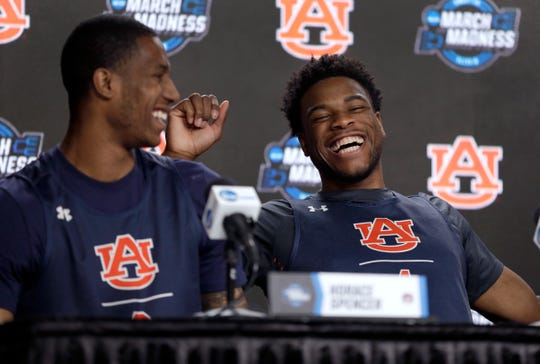 Auburn's Horace Spencer, left, and Malik Dunbar laugh during a news conference at the NCAA Tournament on Saturday, March 30, 2019, in Kansas City, Mo. Auburn is set to play Kentucky in the Midwest regional final on Sunday.