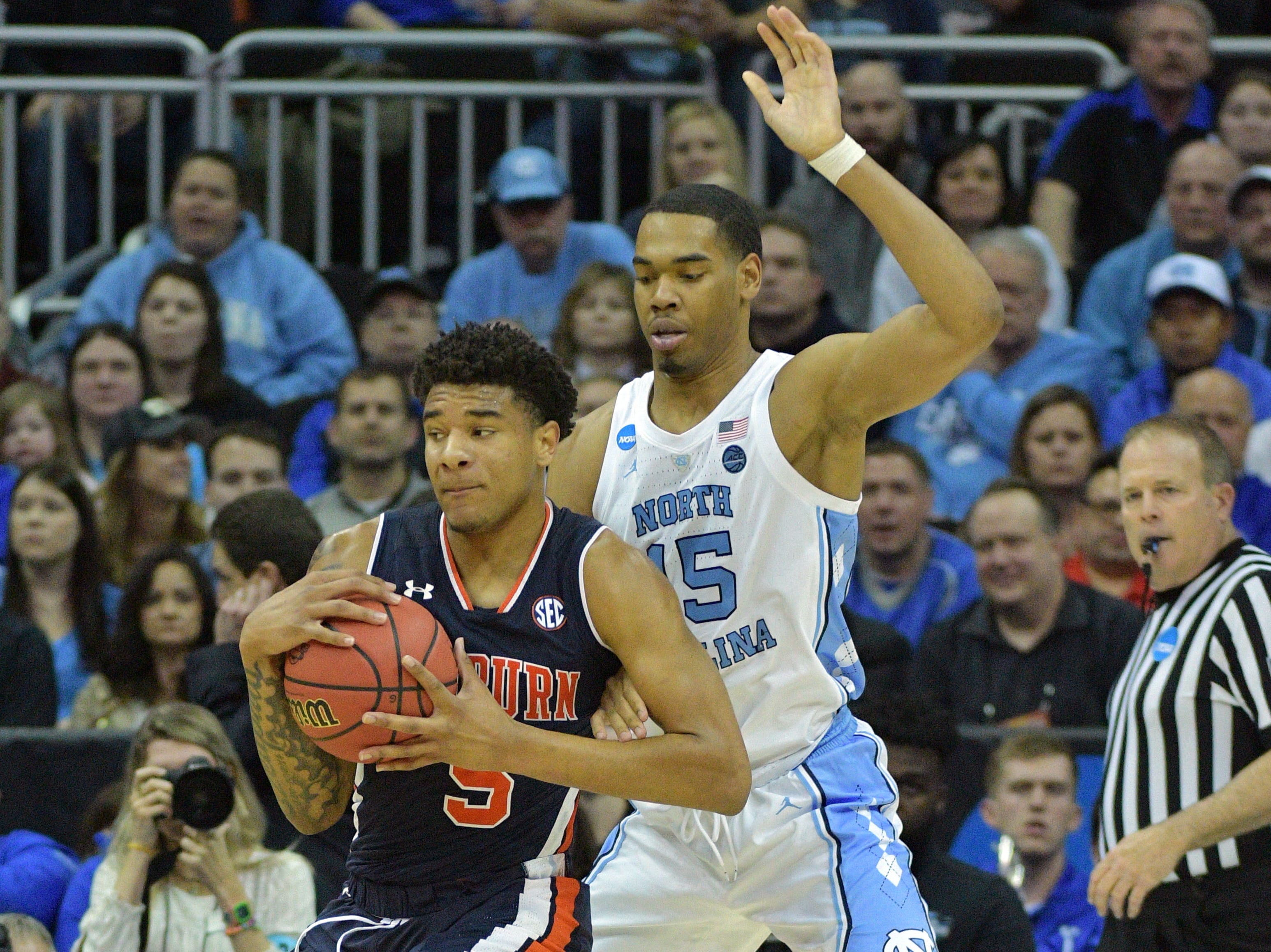 Mar 29, 2019; Kansas City, MO, United States; Auburn Tigers forward Chuma Okeke (5) posts up against North Carolina Tar Heels forward Garrison Brooks (15) during the second half in the semifinals of the midwest regional of the 2019 NCAA Tournament at Sprint Center. Mandatory Credit: Denny Medley-USA TODAY Sports