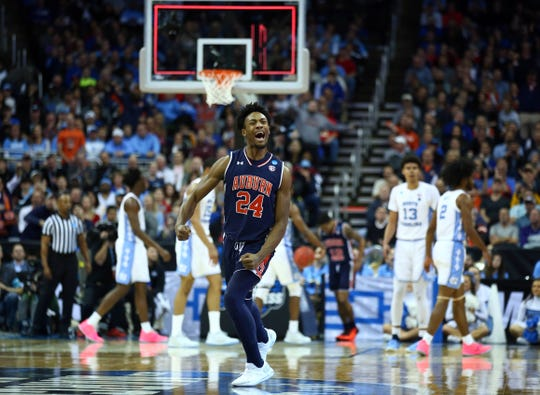 Auburn Tigers forward Anfernee McLemore (24) after a basket at the halftime buzzer against the North Carolina Tar Heels during the first half in the semifinals of the midwest regional of the 2019 NCAA Tournament at Sprint Center. on March 29, 2019 in Kansas City.