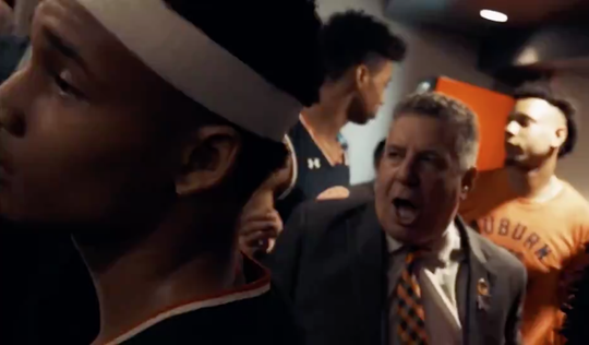 Auburn men's basketball coach Bruce Pearl and members of the Auburn men's basketball team after Friday's NCAA Tournament win against North Carolina in Kansas City, Missouri.