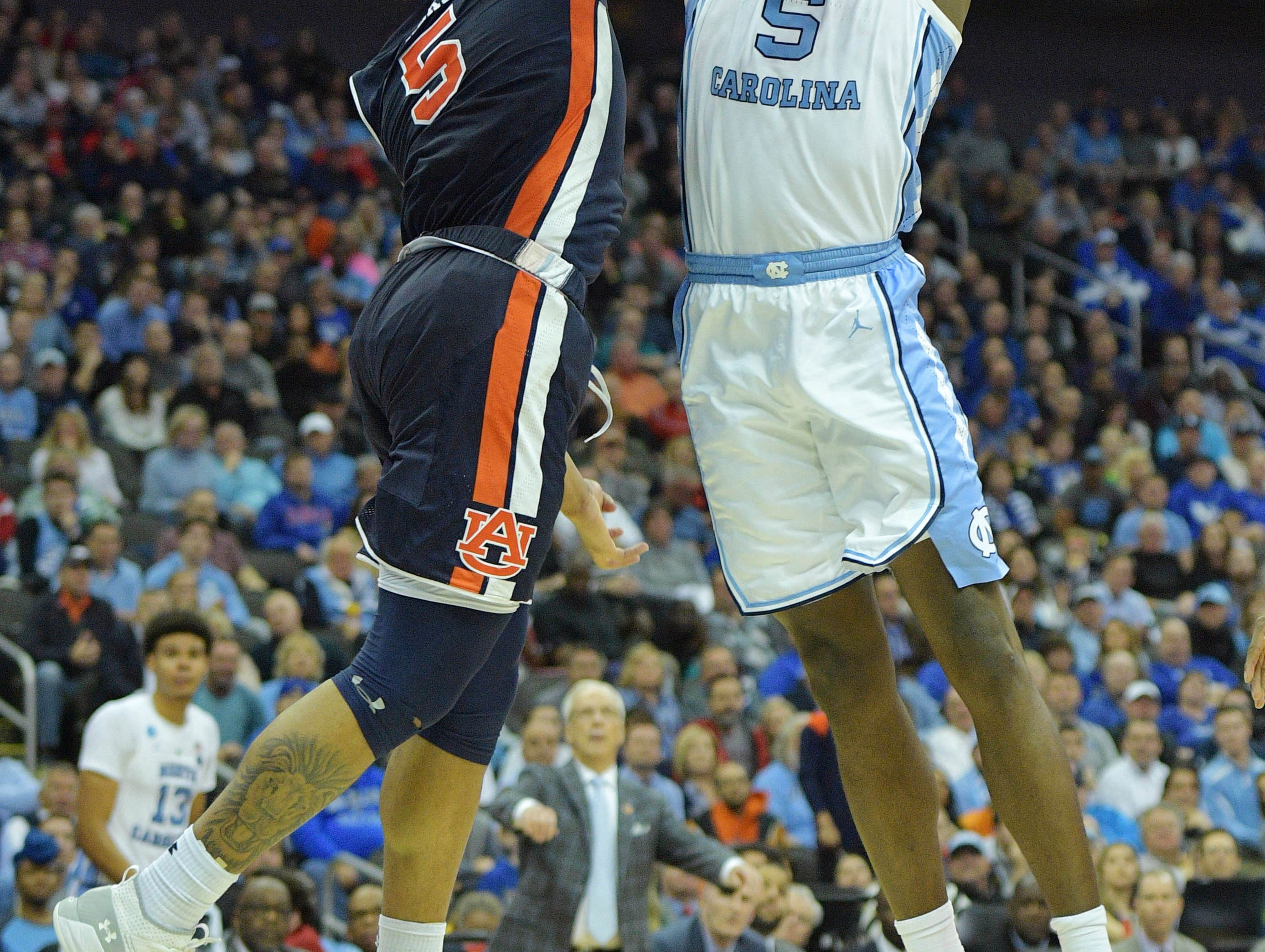 Mar 29, 2019; Kansas City, MO, United States; Auburn Tigers forward Chuma Okeke (left) blocks the shot of North Carolina Tar Heels forward Nassir Little (right) during the second half in the semifinals of the midwest regional of the 2019 NCAA Tournament at Sprint Center. Mandatory Credit: Denny Medley-USA TODAY Sports