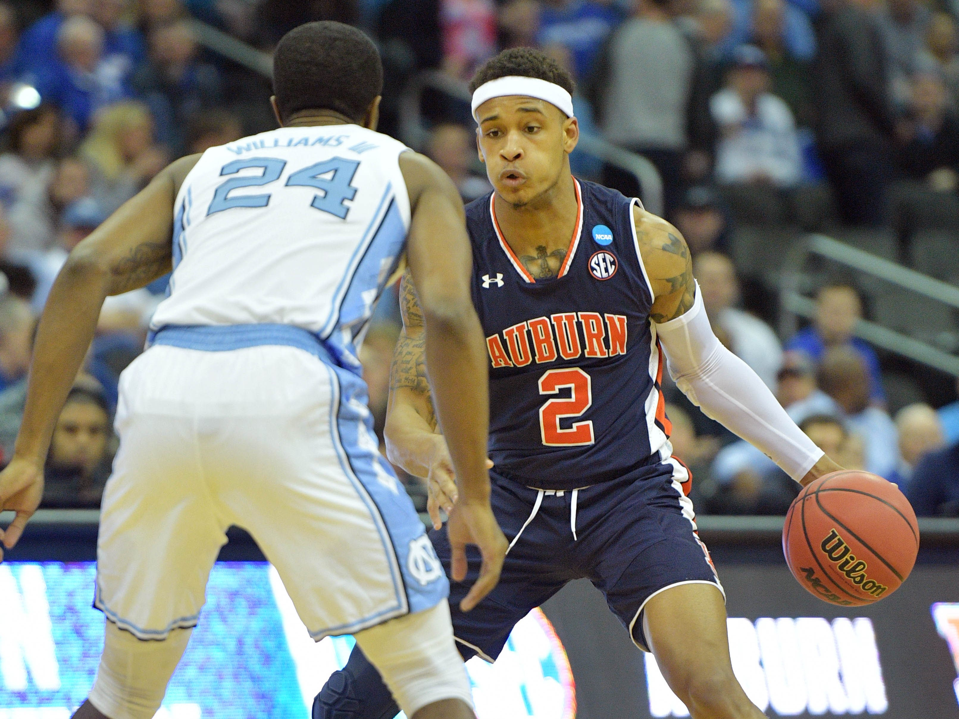 Mar 29, 2019; Kansas City, MO, United States; Auburn Tigers guard Bryce Brown (2) brings the ball up against North Carolina Tar Heels guard Kenny Williams (24) during the first half in the semifinals of the midwest regional of the 2019 NCAA Tournament at Sprint Center. Mandatory Credit: Denny Medley-USA TODAY Sports