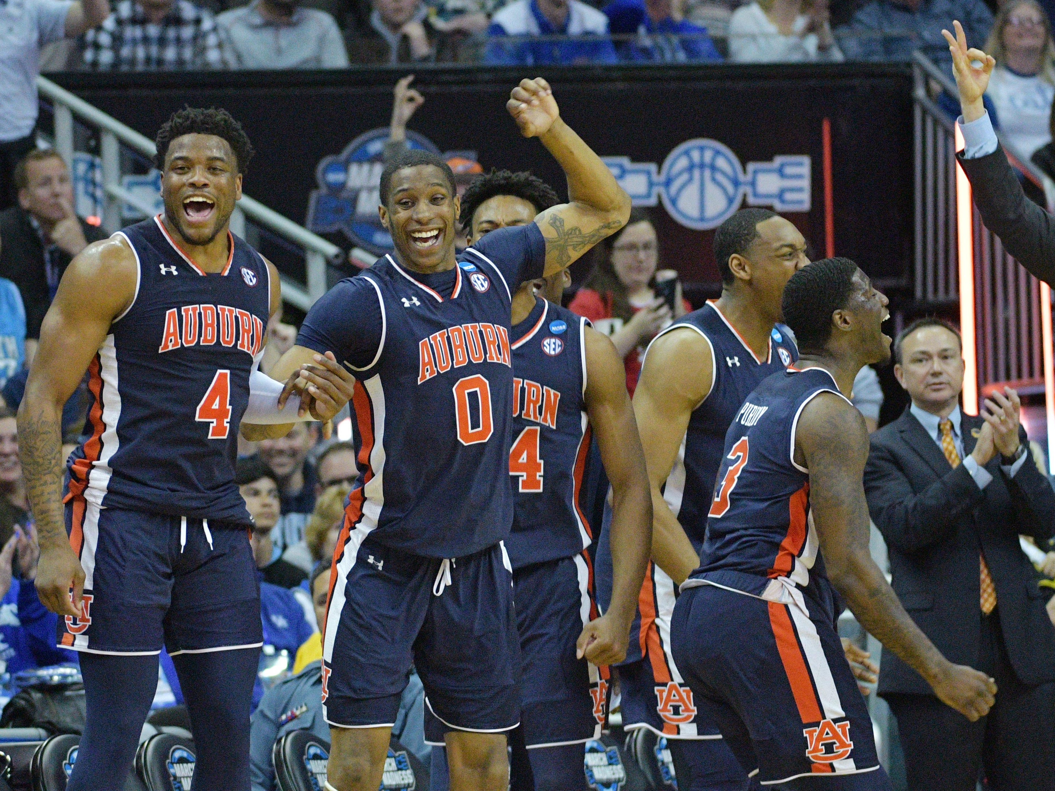 Auburn's Horace Spencer (0) and Malik Dunbar (4) celebrate against North Carolina during the second half in the semifinals of the midwest regional of the 2019 NCAA Tournament at Sprint Center.