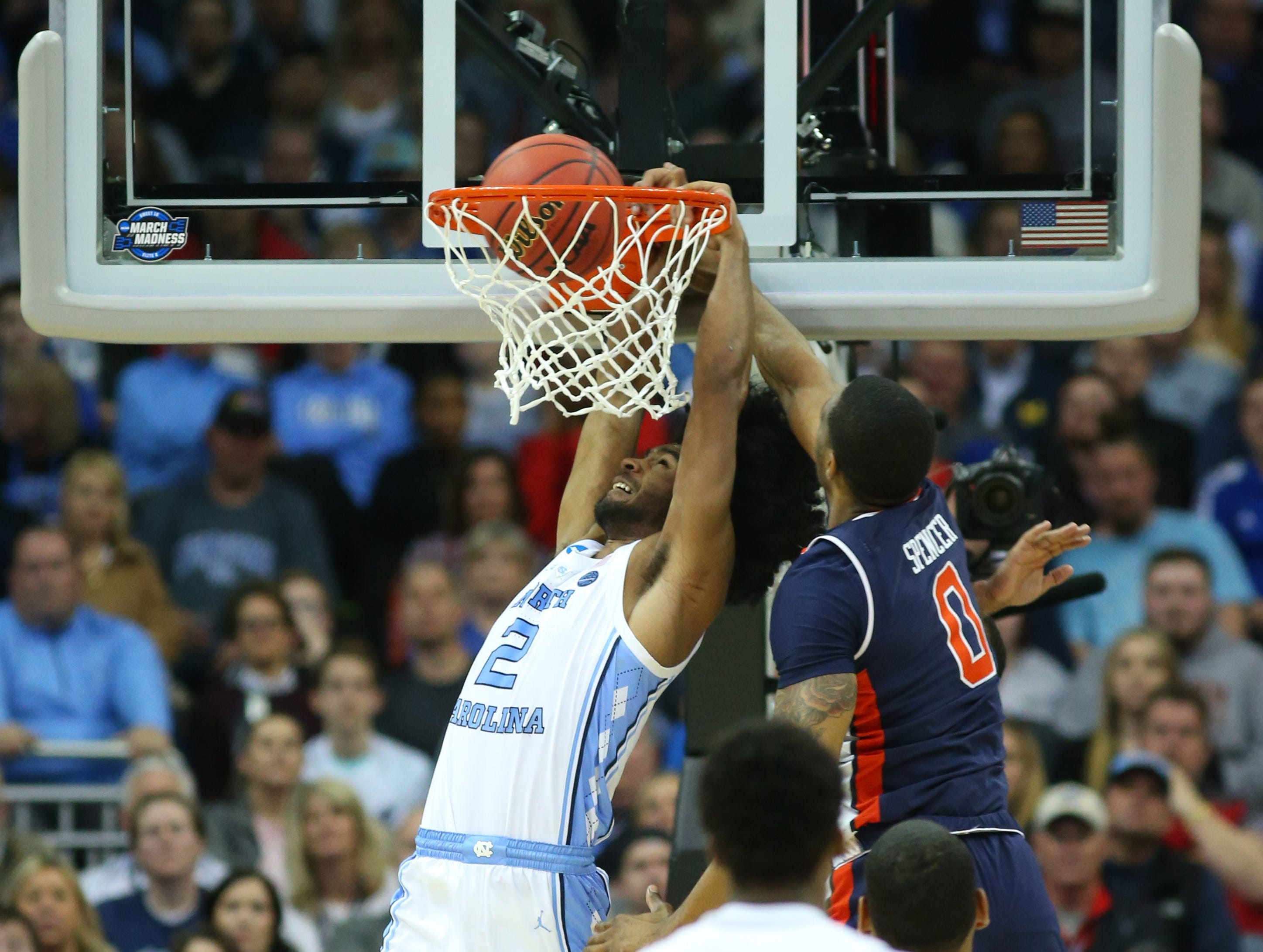 Mar 29, 2019; Kansas City, MO, United States; North Carolina Tar Heels guard Coby White (2) dunks over Auburn Tigers forward Horace Spencer (0) during the second half in the semifinals of the midwest regional of the 2019 NCAA Tournament at Sprint Center. Mandatory Credit: Jay Biggerstaff-USA TODAY Sports